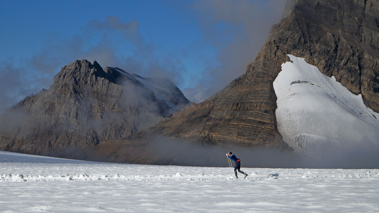 Russell Skiing through the cloud cover of one of the best days of skiing. Photo Credit: Russell Kennedy