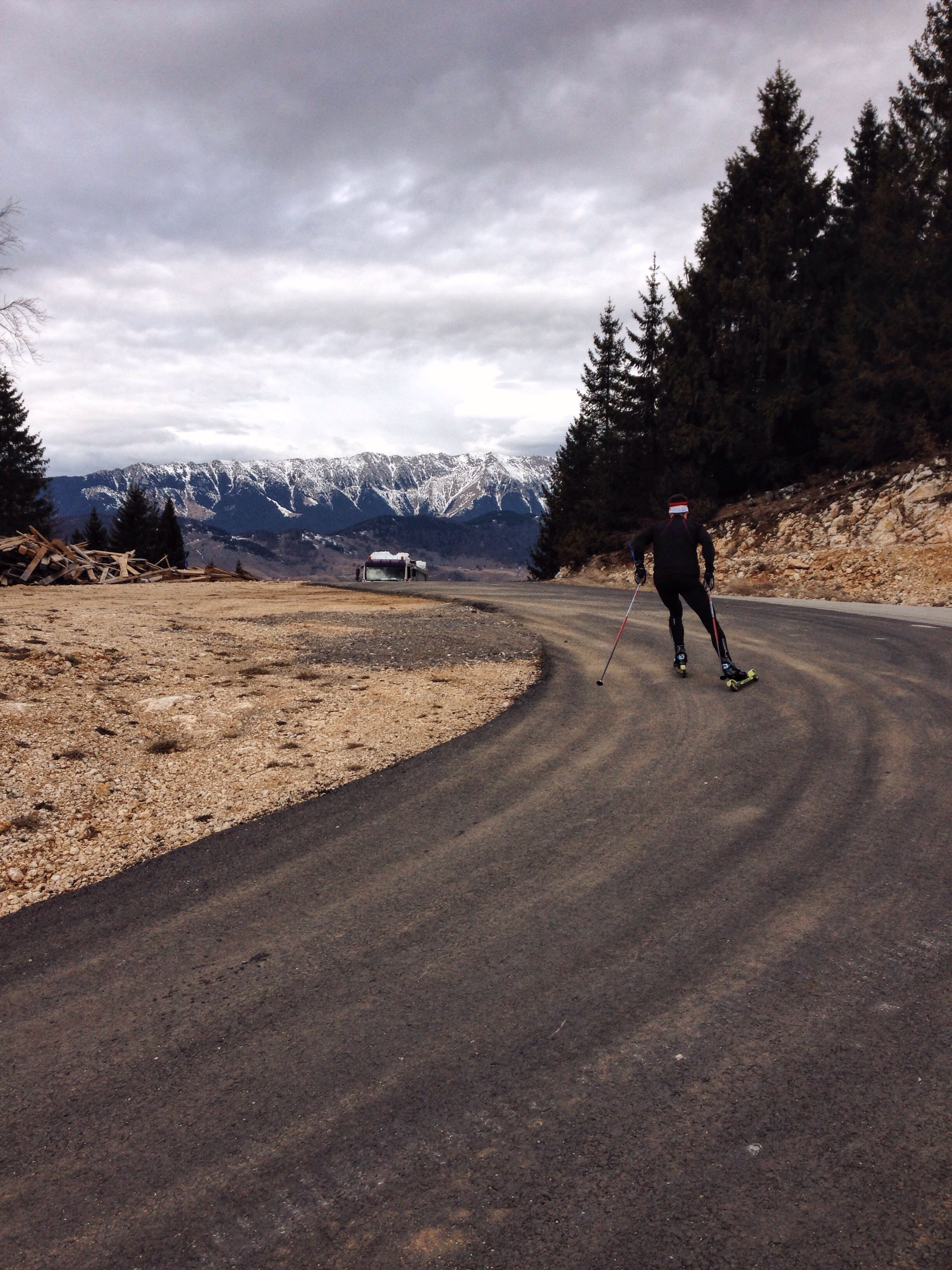 Scott sprinting over the top of roller ski loop.