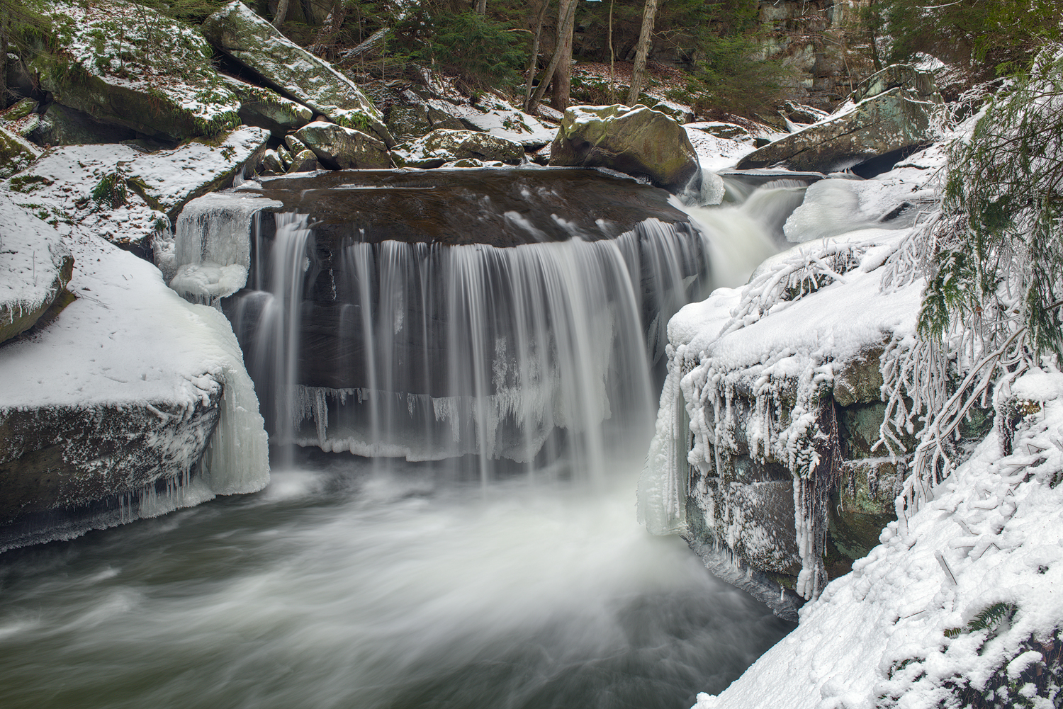 This view shows the large shelf that forms the Lower Falls. At over ten feet in height, the water at a high flow drops into a deep plunge pool.