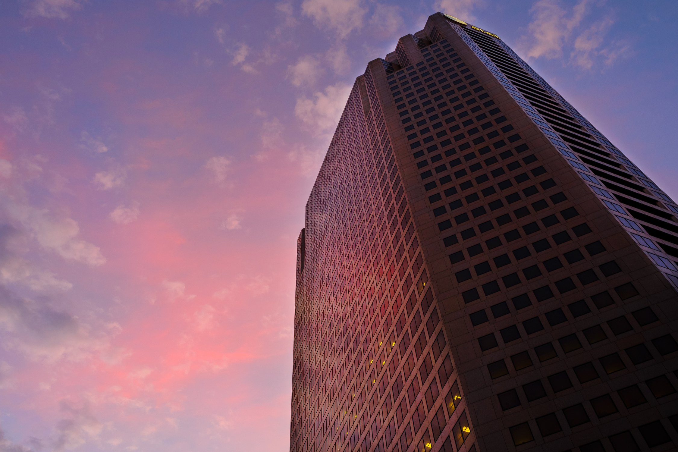 Twilight clouds surround the AT&T Tower. Fuji X-Pro 2 and a Fujinon 16-55mm f2.8.