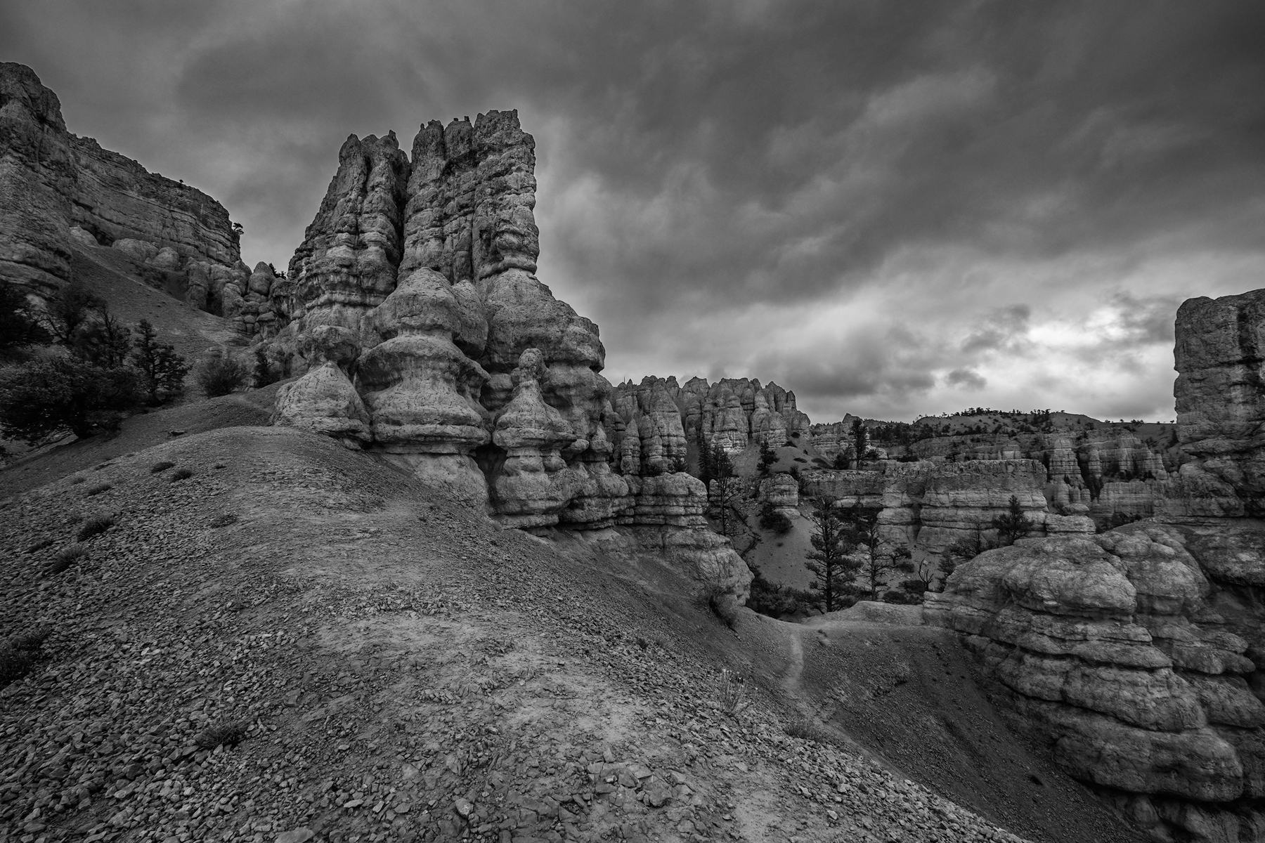 Storm clouds move over the hoodoos of Red Rocks, Red Rock State Park, Utah.