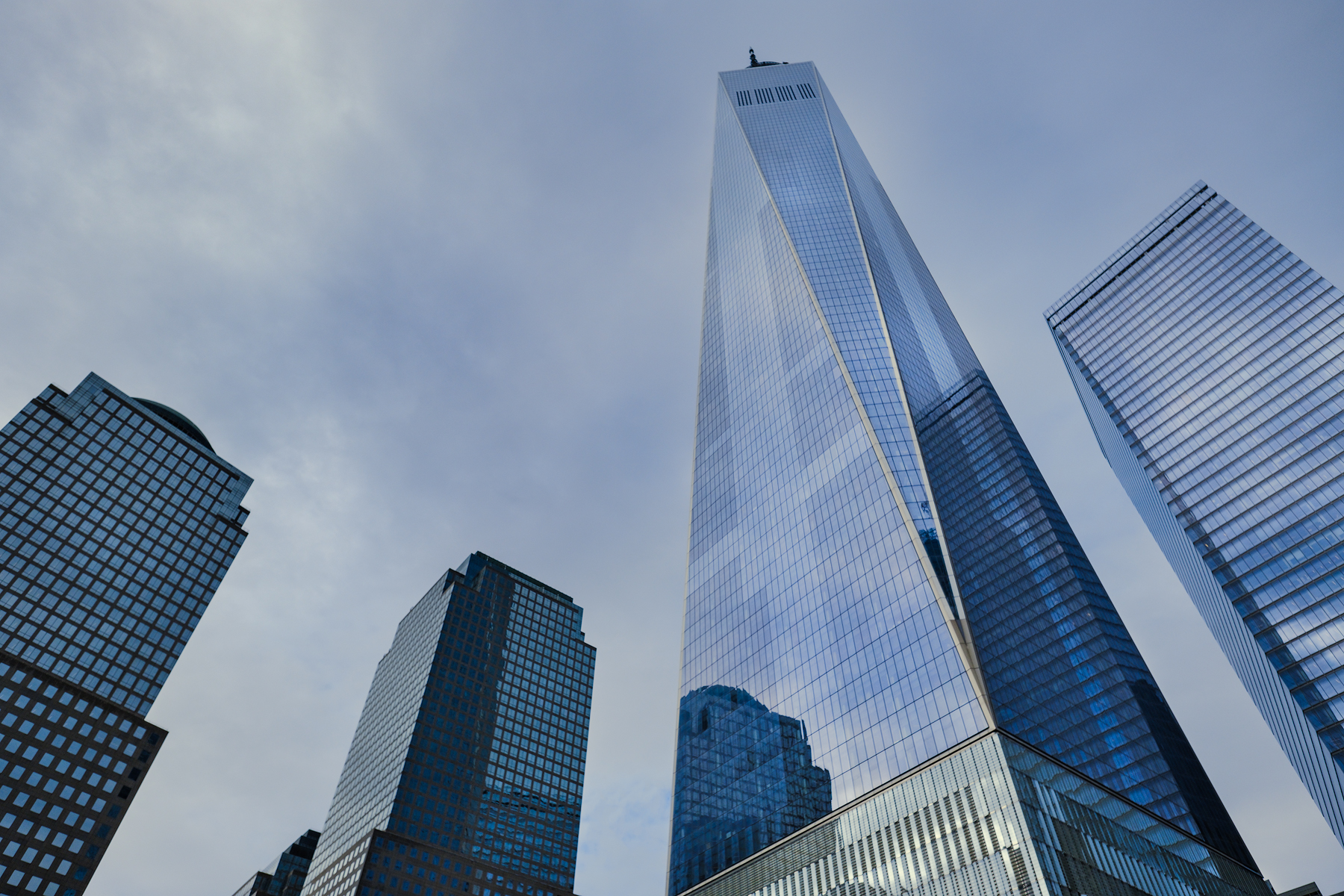 The beautiful blue sky and clouds reflected off of the glass skin of The World Trade Center Tower.