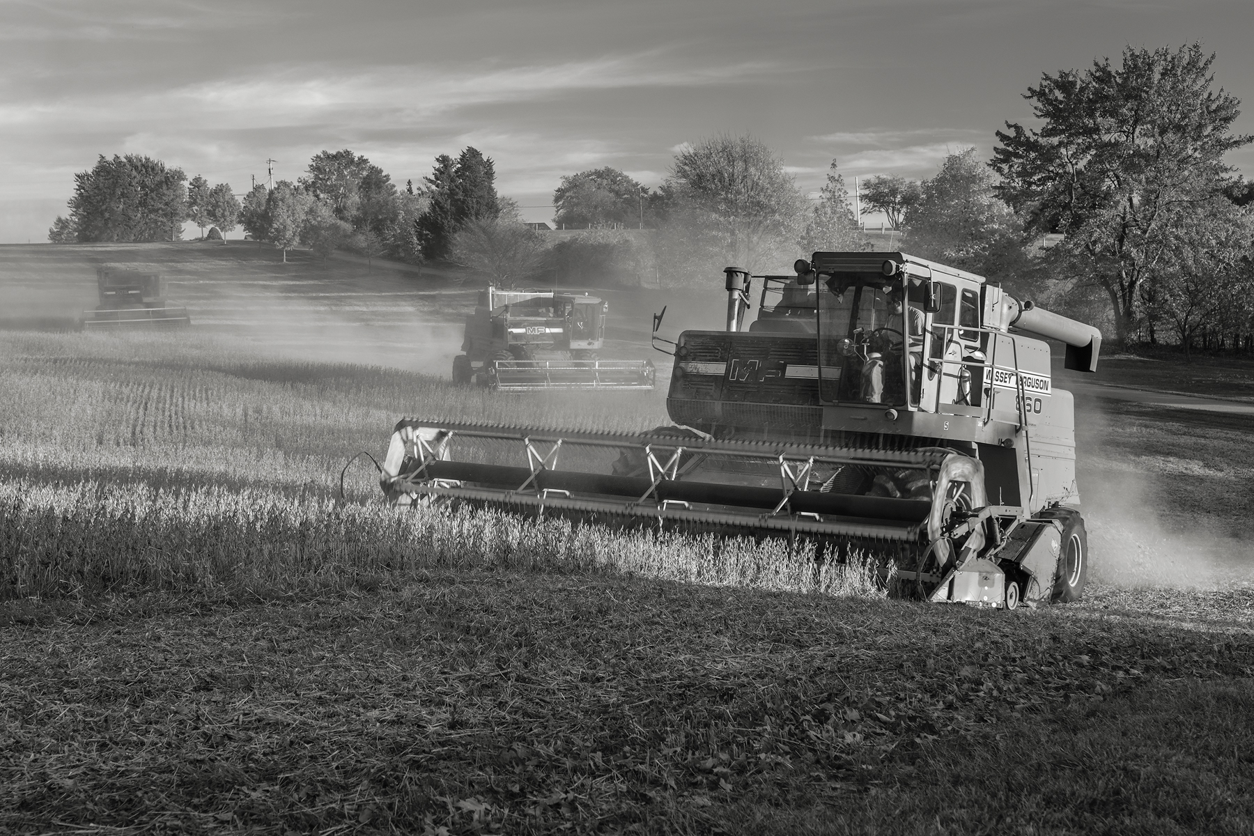 Three combines work the soybean fields at Shepherd's Hey Farm, MD. Fuji X-T2 and a Fujinon XF55-200mm at 55mm. Image exposed at ISO 200 at f5.6 for 1/60 of a second.