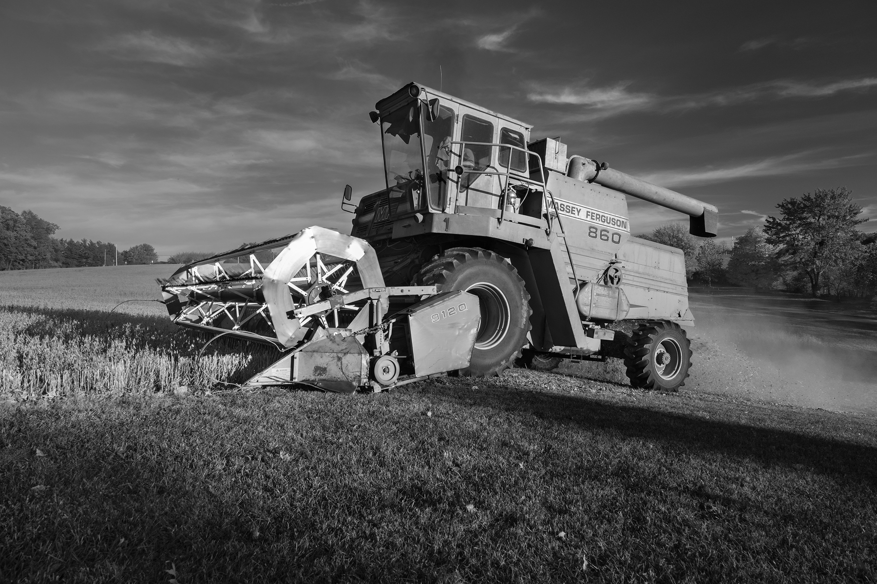 A big combine cuts along a new row. Fuji X-Pro 2 and a Fujinon XF16-55mm at 16mm. Image exposed at ISO 400 at f5.6 for 1/60 of a second.