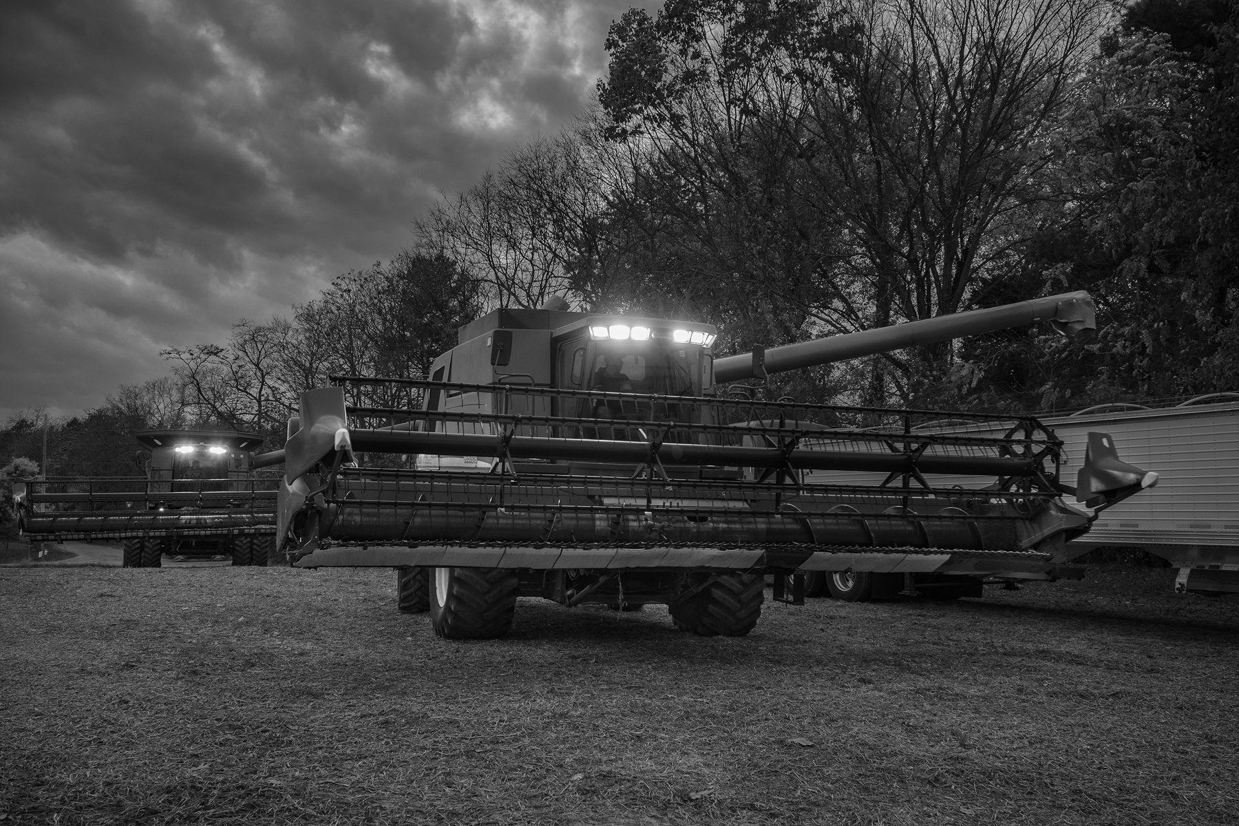 As night descends Aden and Steve finish unloading soybeans from another pass in the field.Fuji X-T2 and a Fujinon XF16-55mm f2.8 WR at 16mm. Image exposed at ISO 800 at f5.6 for 1/30 of a second.