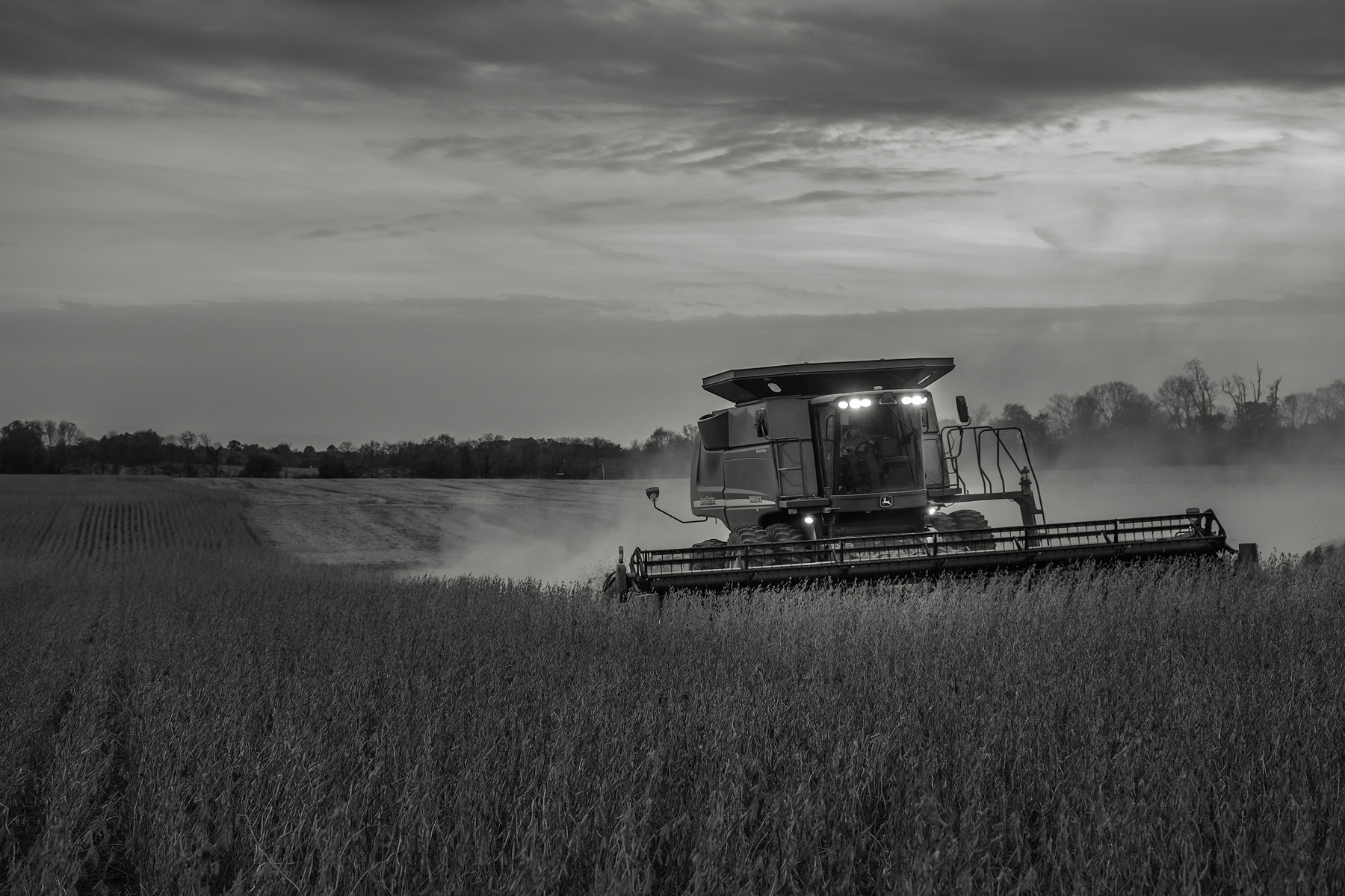 Running lights from Steve's combine light the way as another row is harvested.Fuji X-T2 and a Fujinon XF16-55mm f2.8 WR at 35mm. Image exposed at ISO 800 at f4 for 1/60 of a second.