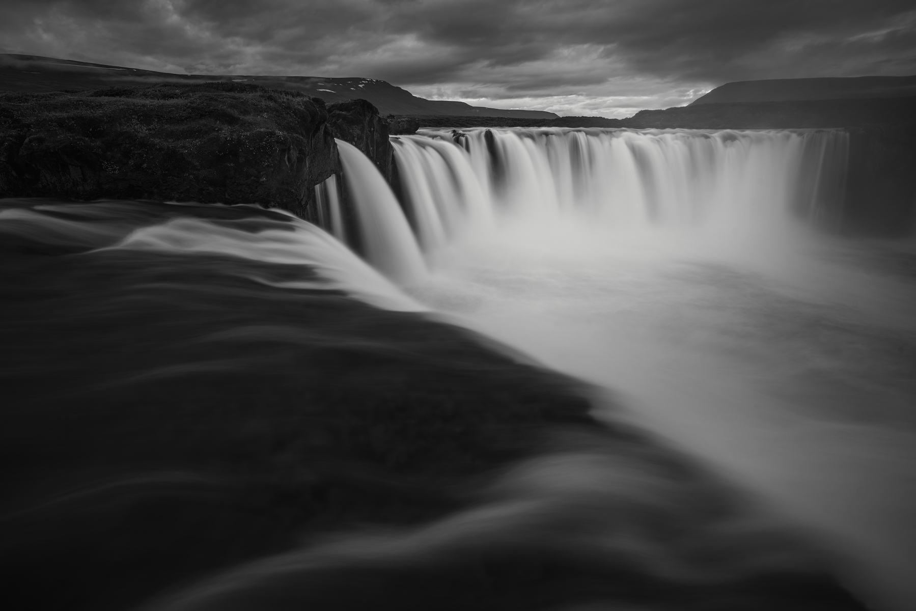 Twilight at Goðafoss Waterfall looking along the left side towards the main falls. Image Notes: Sony a7RII and a Tokina FiRIN 20mm f2.0 FE MF. Image exposed at ISO 100 at f11 for 10 seconds.