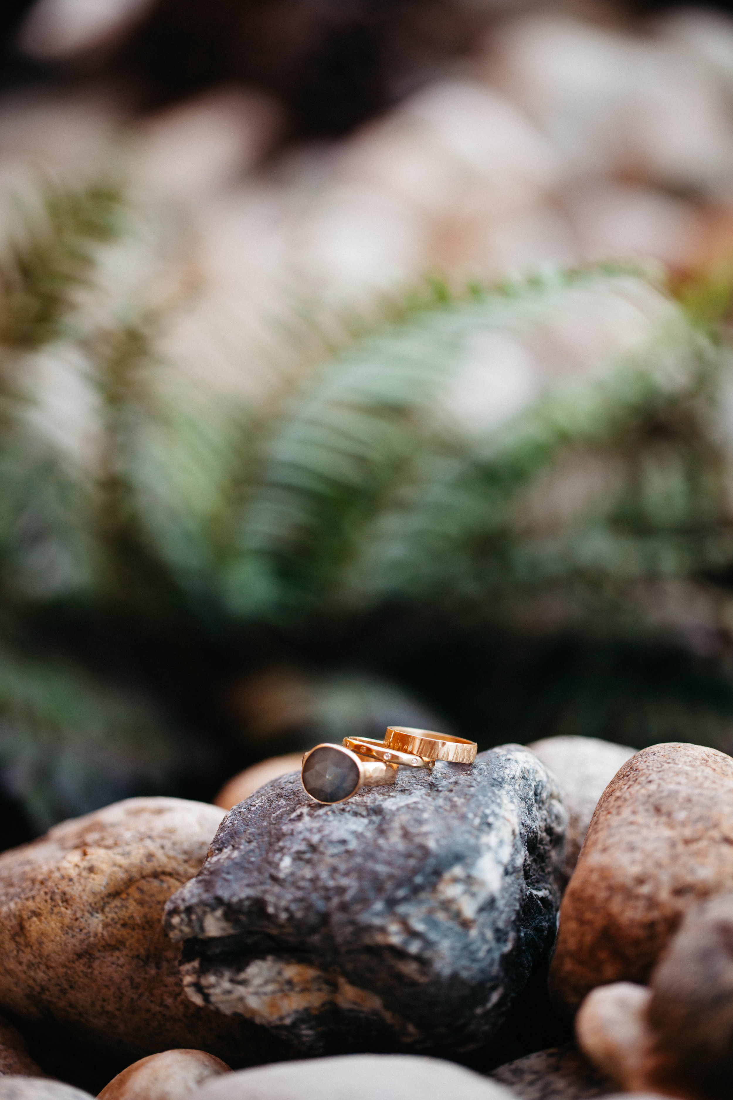Rings by Leslie & Jared:   18k yellow gold; 4mm textured flat band, 2.5mm faceted half round band with flush set diamonds, and organic shap  ed rose cut sapphire on a hammered band.   Photo by   Tim Kressin
