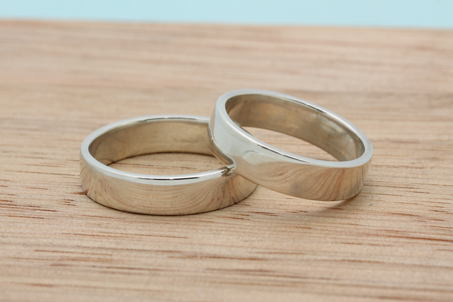 Amanda and Declan's flat bands in palladium sterling silver, with a smooth polished finish.