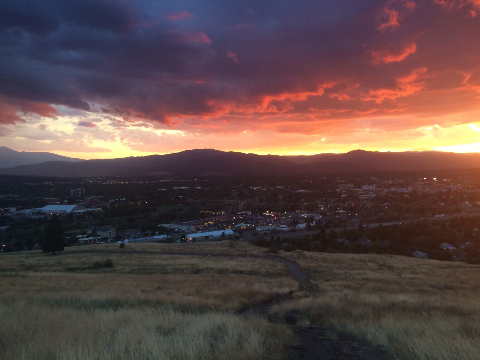 Low clouds and a late-summer sunset over Missoula. Photo by Peter Gurche.