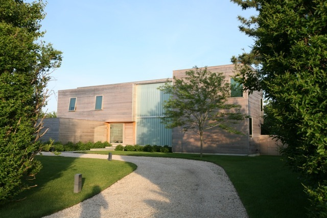 Modern - Bridgehampton, New York Utilizes a large open space for an elegant kitchen and dining
