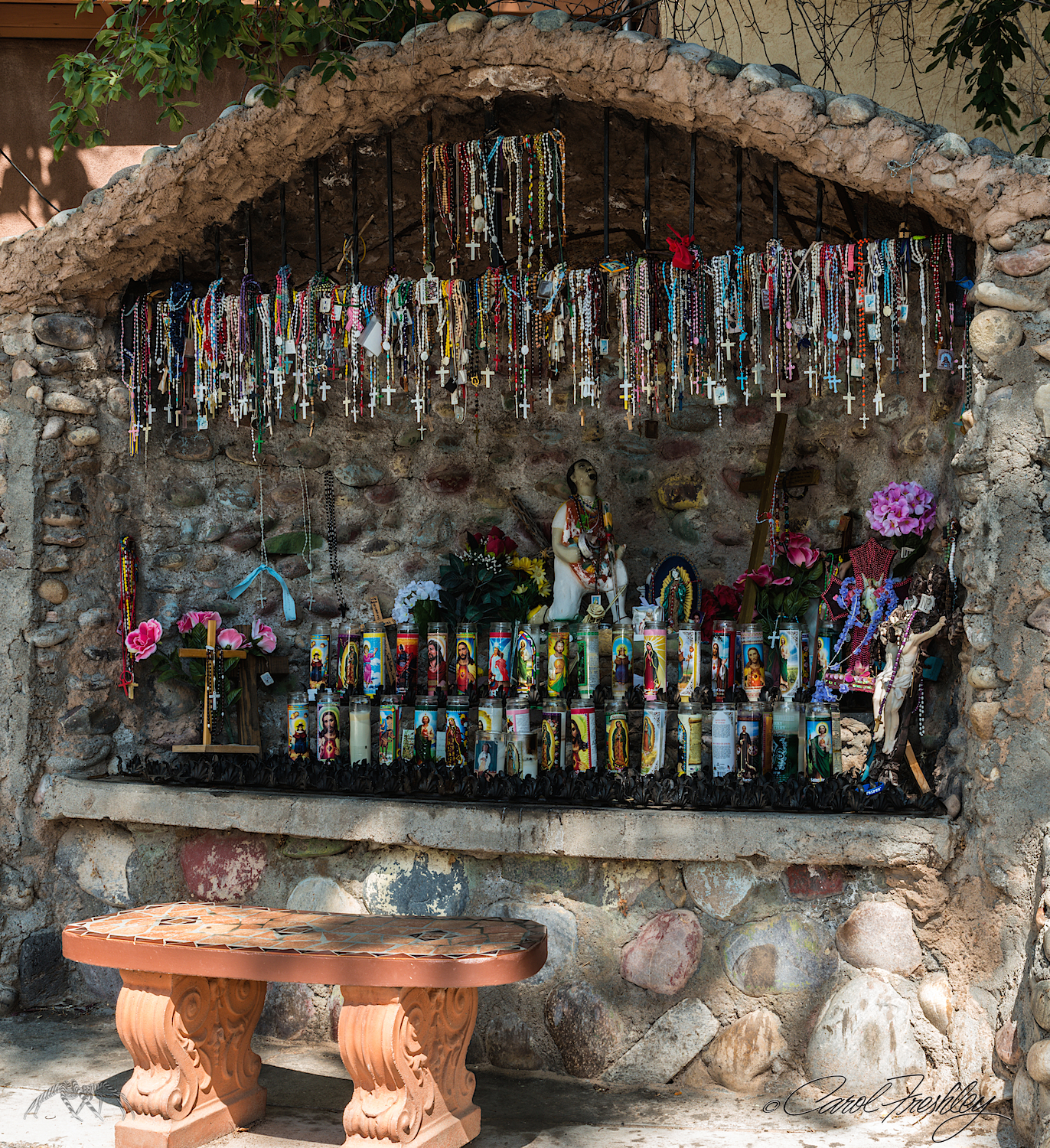 Several places such as this one are found throughout the site. The gift shop sells candles and many other religious items that can be placed in these sites.