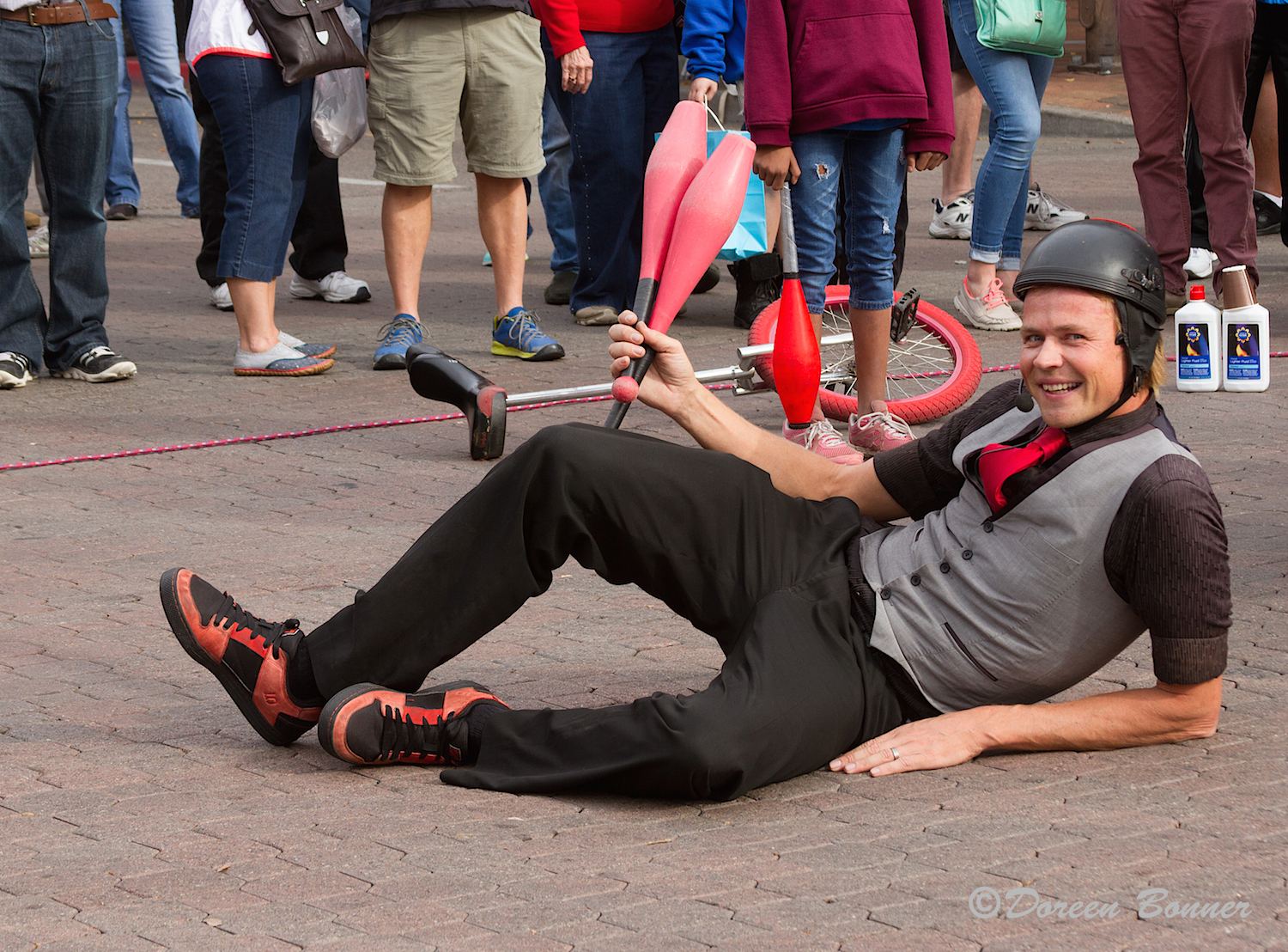 "The unicyclist saw Doreen with her camera and asked her if he laid down would she take his picture.  He did and she did.  Then he remarked, ""That'll be $20.00.""  Quite the comedienne!"