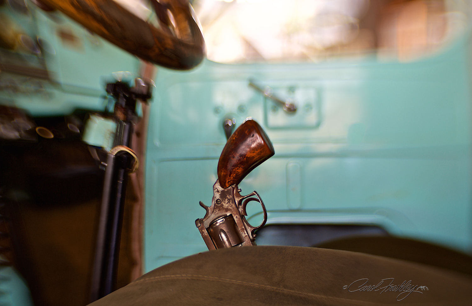 Pistol for the brake, double barrel for the stick shift and a gorgeous custom interior and wood steering wheel!