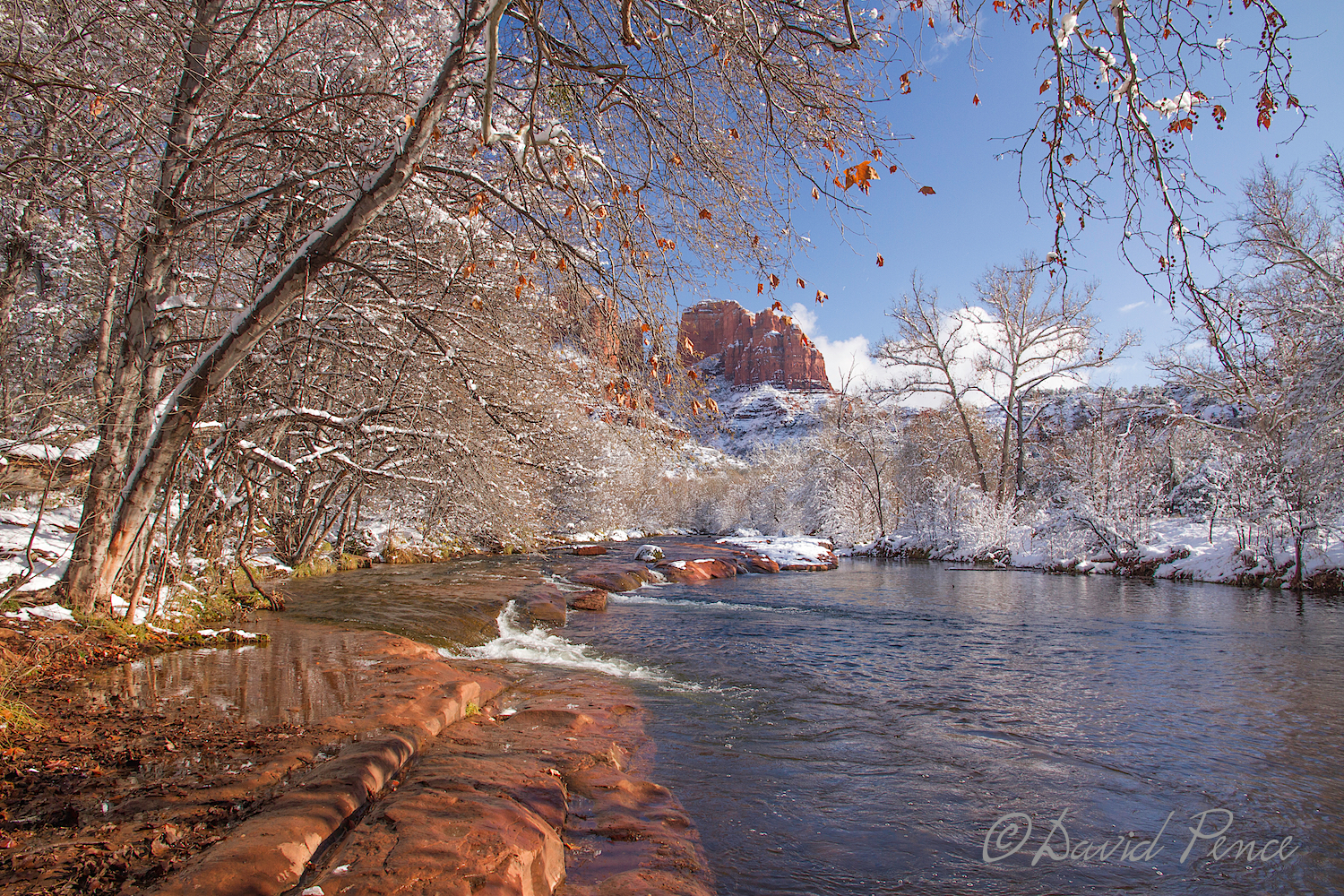 David's image, for me, captures a much better representation of the red rock, which then complements that lovely orange leaf above and the red in Cathedral Rock in the background. He cuts out the area across Oak Creek which really does not add anything to the image. It is a much tighter, more focused and interesting image than the one I took above. If you are asking what this would look like if the water was smooth and silky, you are asking a good question! EXIF: ISO 200, 16mm focal length, 1 EV, f/9 at 1/100 with Canon EOS 7D and EF-S15-85mm f/3.5-5.6 IS USM lens. Minimal post processing.