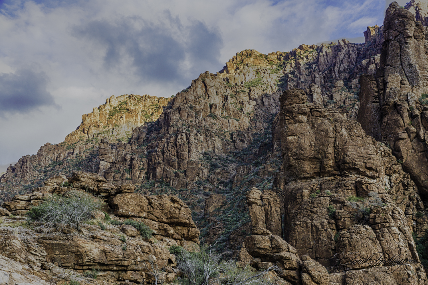 These are the majestic rocks that are on both sides of the canyon as you approach the tunnel just before going into Superior.
