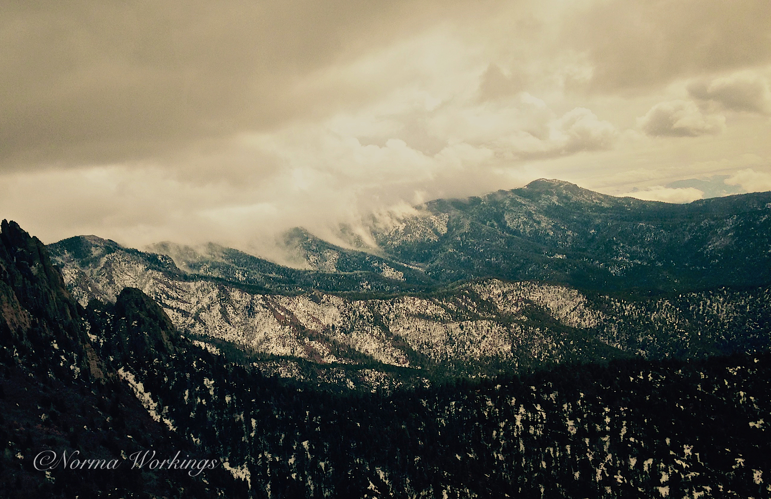 We both loved how the clouds were drifting down the canyons of the mountain.