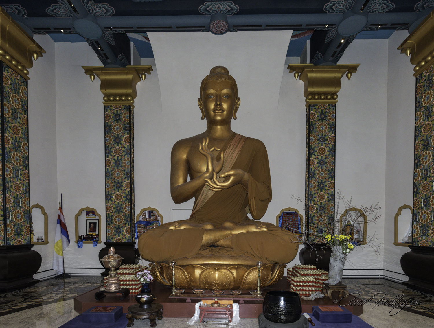 We waited quite a while for the room to be empty so we could walk closer to the front and around the sides without distracting or disturbing any person who had come to meditate. Notice the small alcoves around the room. Each one had different items, as shown below.