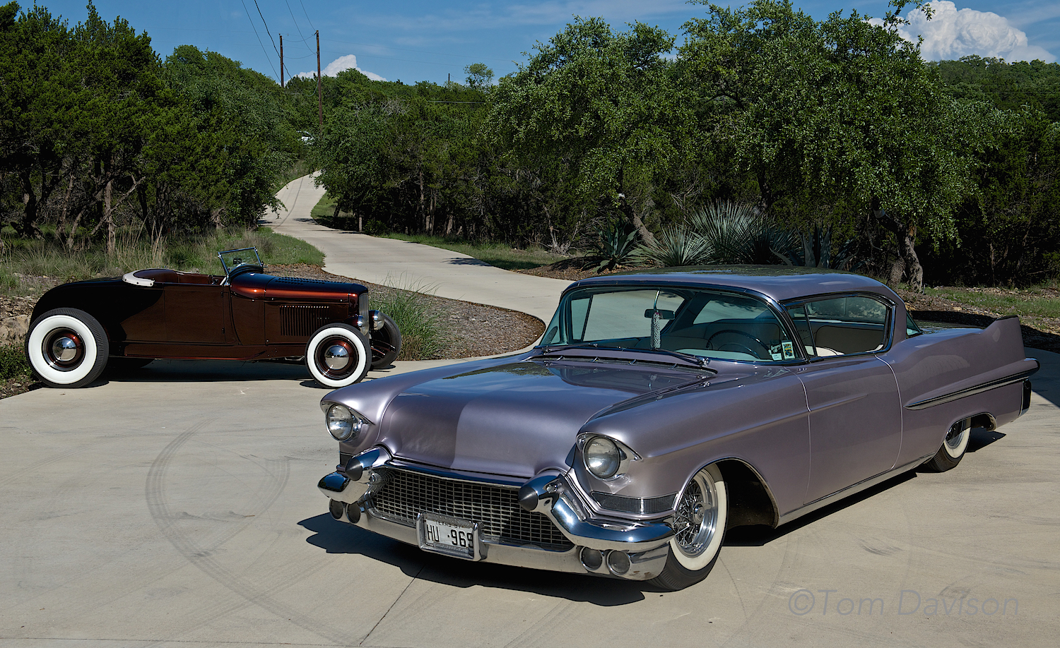 The back car is a 1931 Ford roadster and the front car is a 1957 Cadillac, owned by Steve the show's promoter.