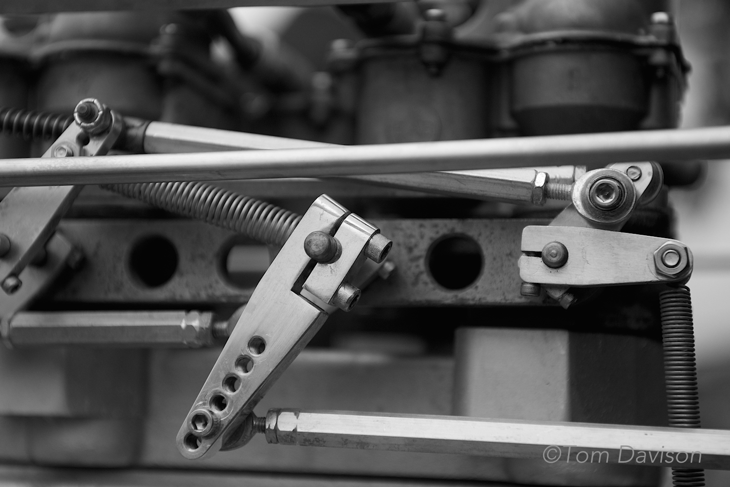 This is detail of a handmadethrottle linkage on a supercharged Oldsmobile engine.