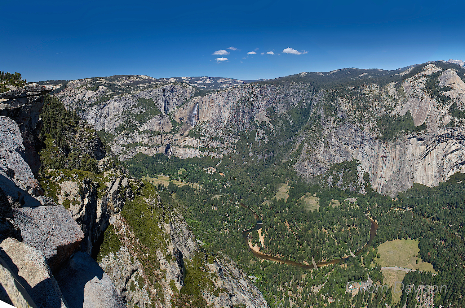 A sixshot stitched pano taken at Glacier Point. If you look carefully you can spot both Upper and Lower Yosemite Falls and the winding Merced River.