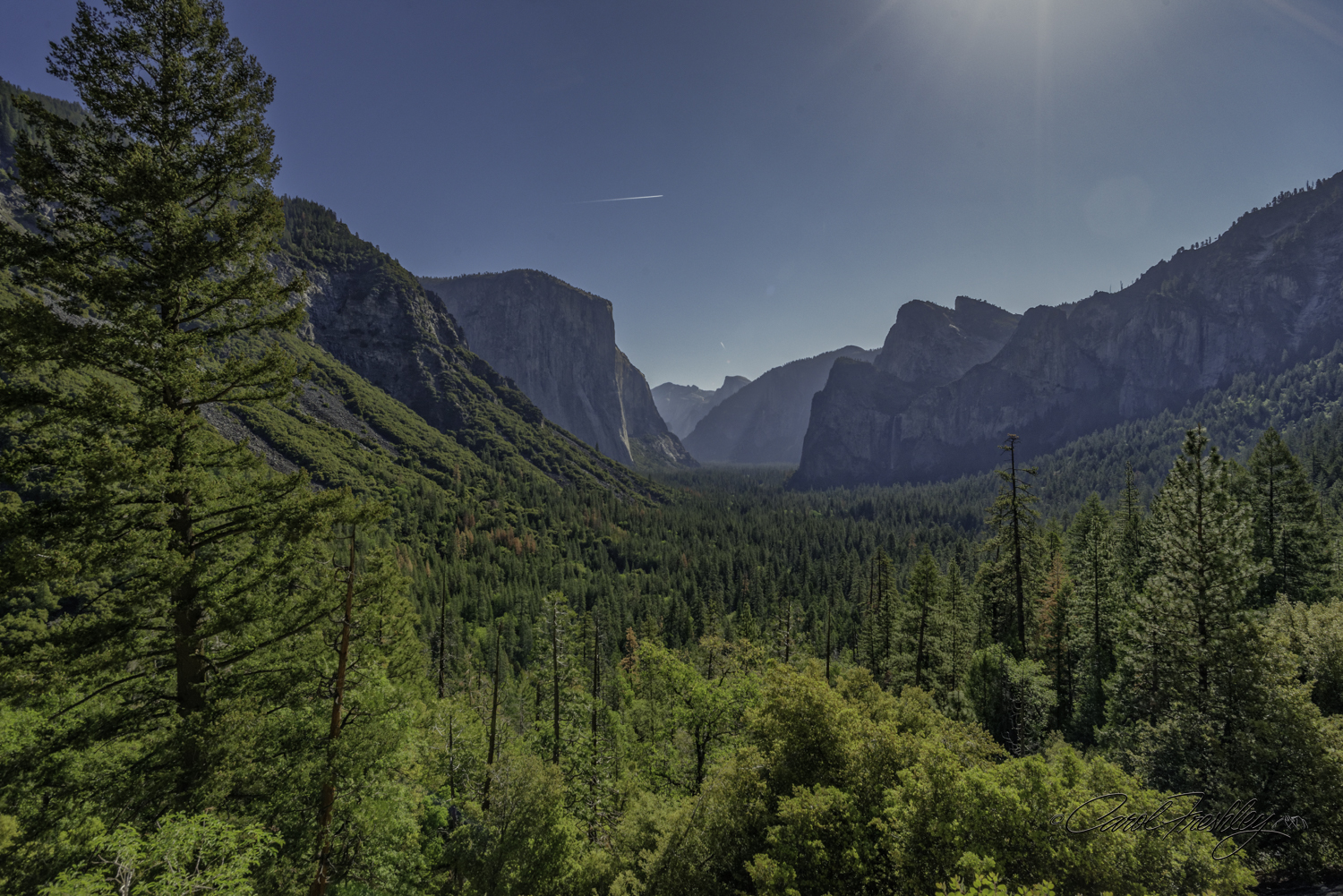 Taken with new 20mm prime Nikkor fl1.8. Shot taken with my new 20mm prime Nikkor f/1.8. A shot from Tunnel View with haze and midday light!! But, worth giving you asense of the Yosemite Valley.