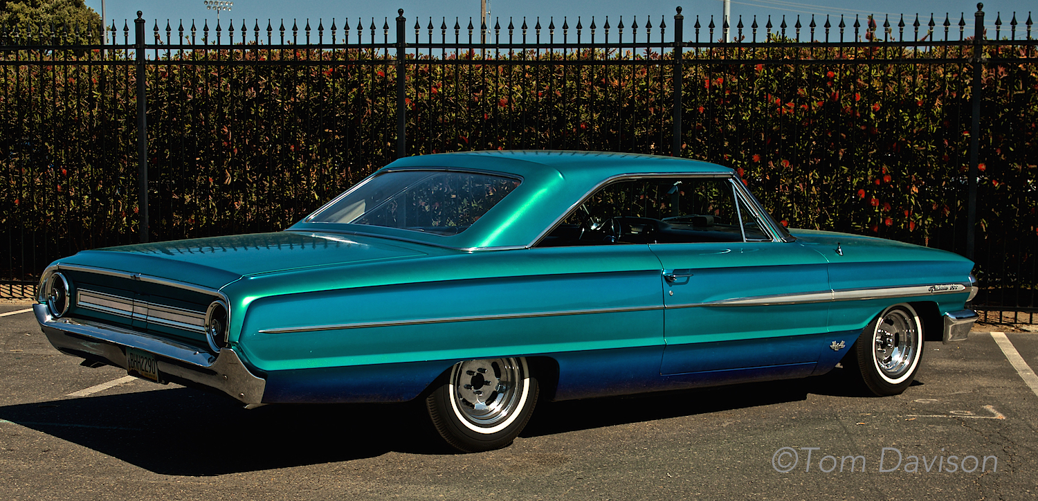Tom's ride to the show. This is Jerry's 1964 Galaxie. It has the paint job that Tom applied to it in 1964. Jerry bought it for himself for his 20th birthday and asked Tom to paint it with three color blend of transparent blue, green and purple. It wonbest paint award at the World of Wheels Show in Kansas City in 1966. It had been in storage since 1972 and Jerry just recently got it out to restore it. Paint job has held up well!!!