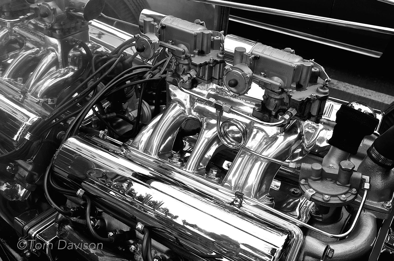 Hot rodded Cadillac motor poweringin an early model Ford hot rod.