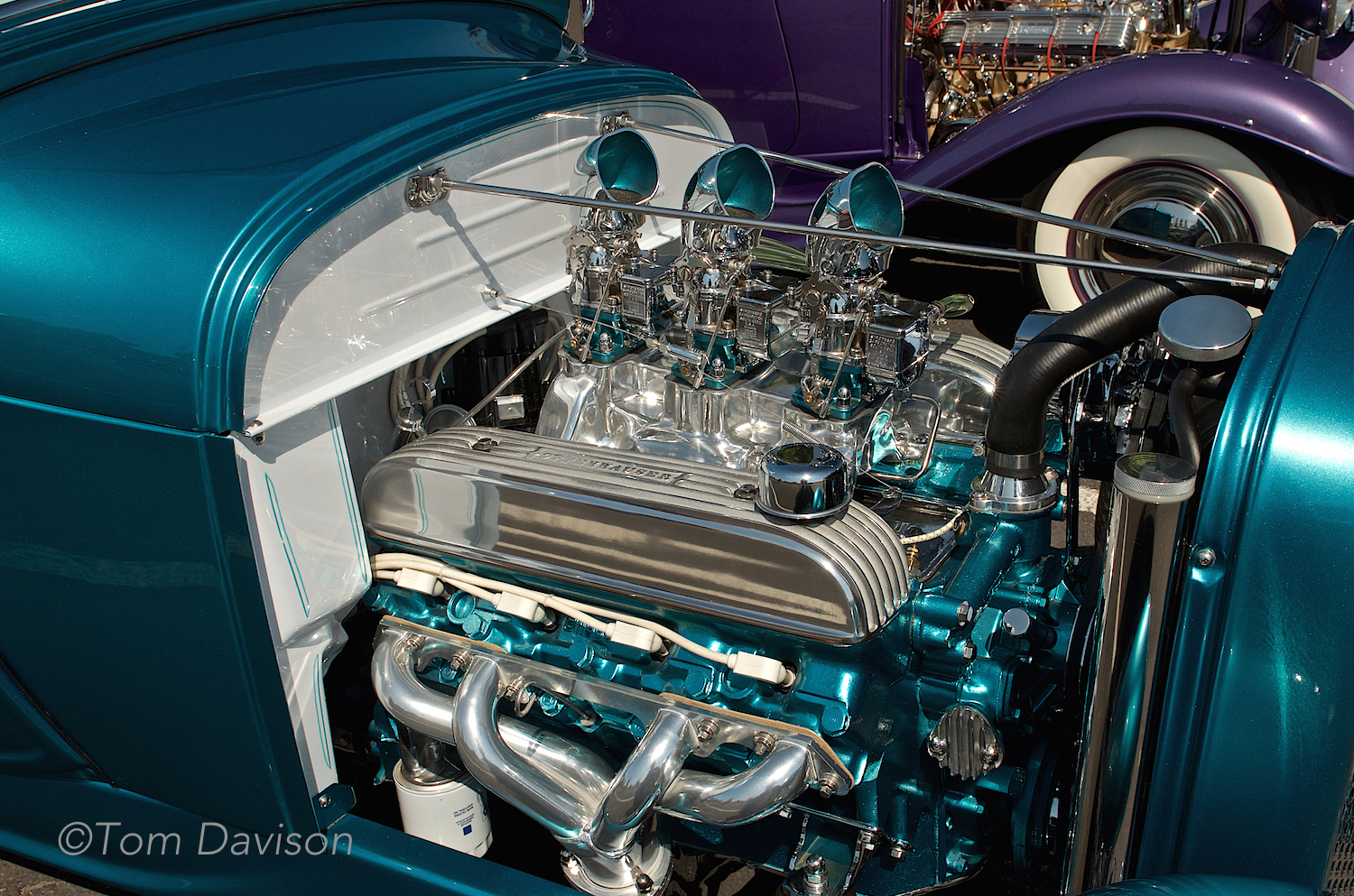 A Buick V8 powering a Model A roadster, done in the style of a 1960s-built showrod. This stuff gets rather technical and Tom appreciates the nuance . . . I just like the color a lot and like the way it pays attention to detail such as painting the inside of the carburetor induction scoops (that is why they call it a showrod).