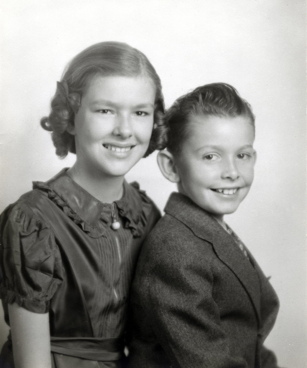 Shown here with her brother Joe. She was particularly fond of her younger brother,and shared his love of cars and racing.I believe this photo was taken when she was about 11. Joe died in his early 30s while our family was living in Buga, Colombia. Mom could not make it back for his funeral and I remember her crying for several days, feeling, I am sure, so very far away from the brother she had loved.