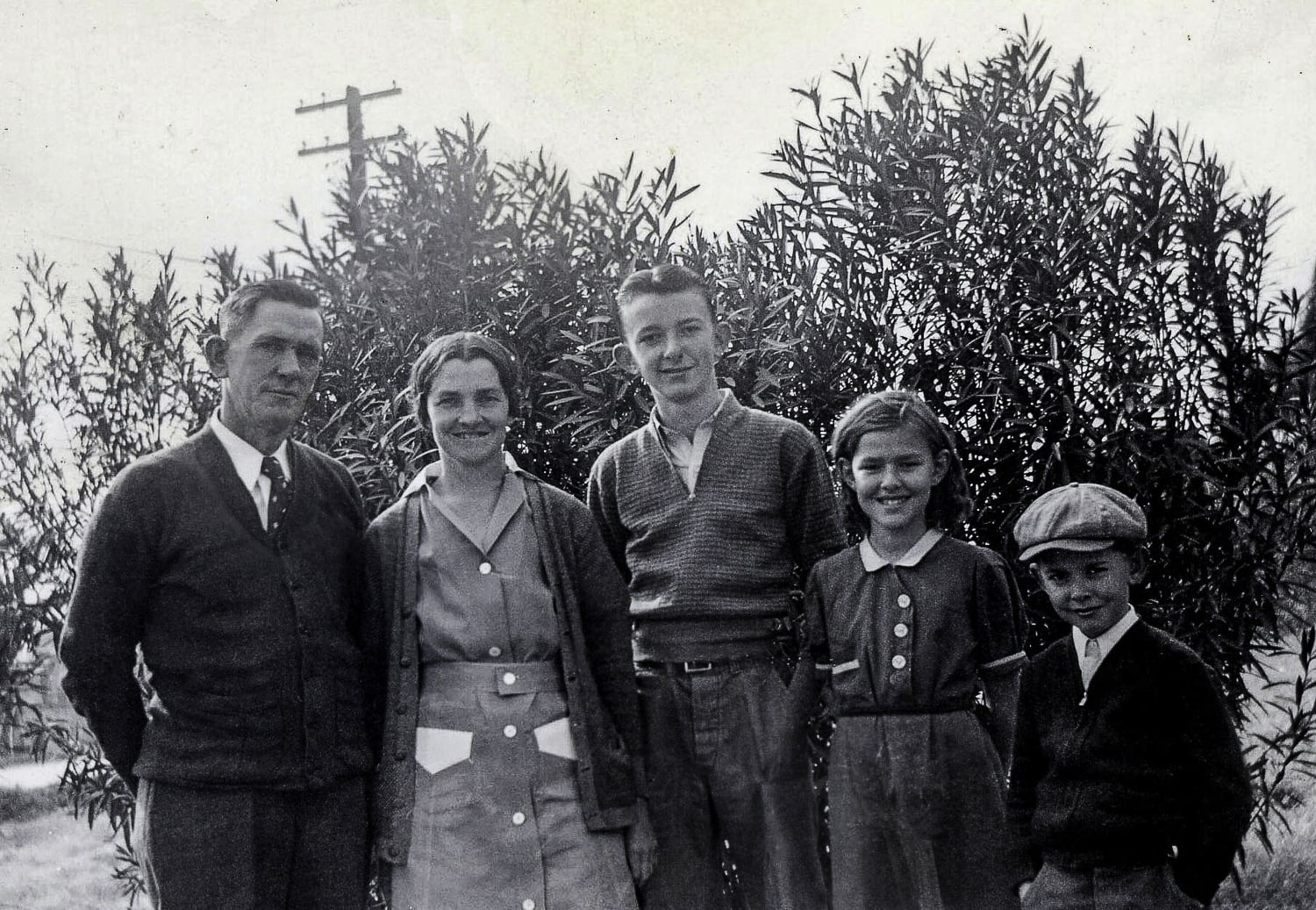 The only photo we have of her with her parents and both brothers. Her dad was a bricklayer and had difficulty finding work in Phoenix. He returned to Charleston leaving my grandmother to raise the three kids on her own. This meant that our mom took on a huge responsibility for taking care of the house, cooking and watching over her younger brother. She later recalled with pride how she managed the food budget her mother gave her. She was 12.