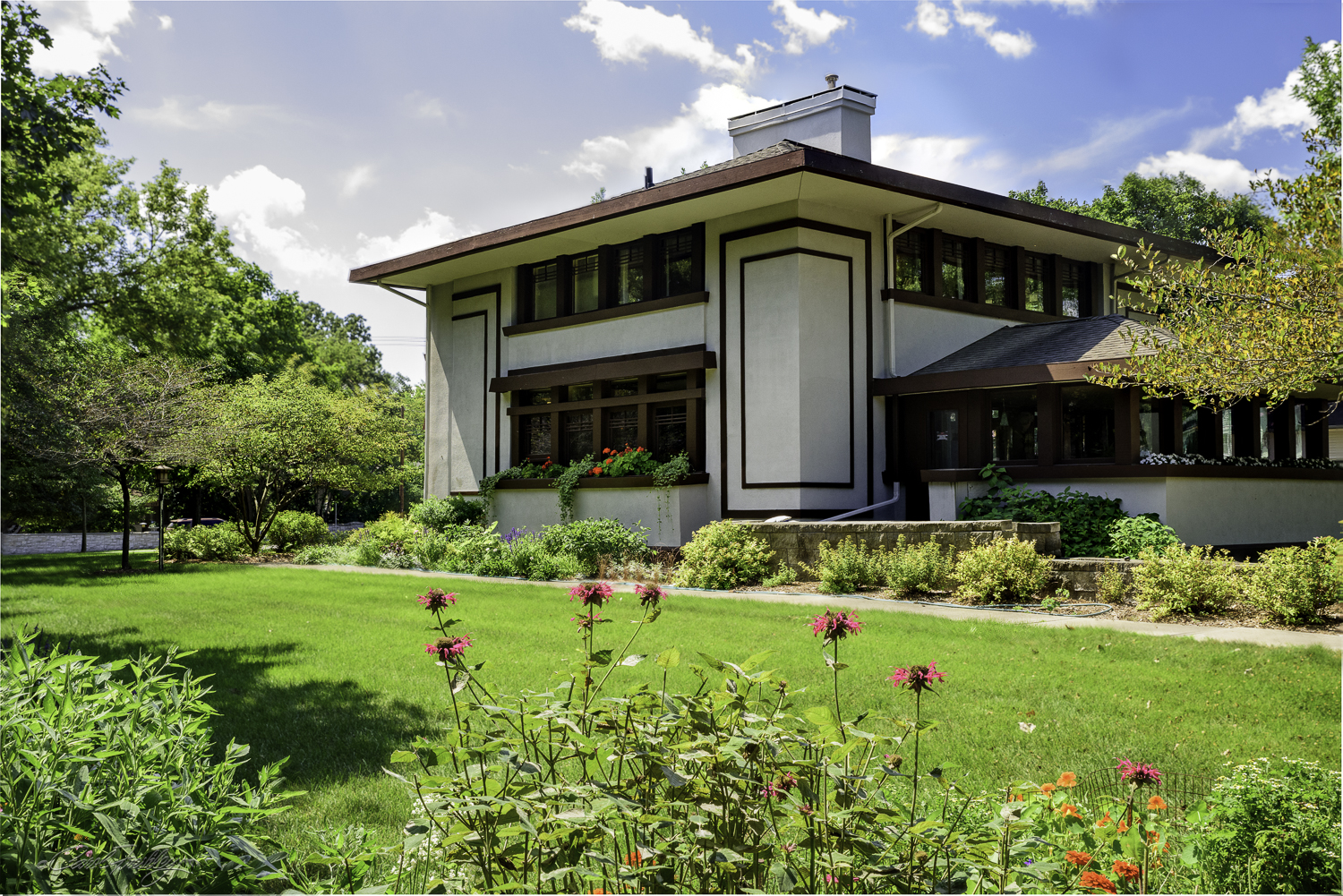 """This is known as the Stockman House. It was designed by Frank Lloyd Wright based on his open floor plan described in his 1907  Ladies Home Journal  article """"A Fireproof House for $5,000. The design was to become the Prairie School approach to housing needs of America's middle class. The home is now owned by the River City Society for Historic Research and is open to the general public as a house museum. It was not open when we visited the site."""