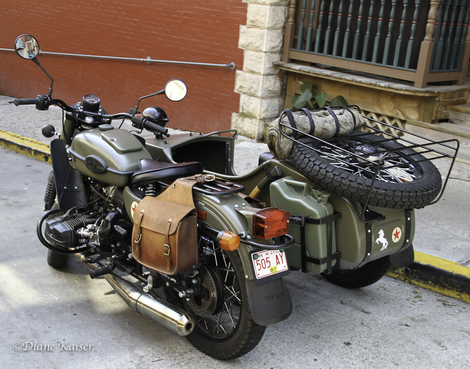 We spotted this and it generated a whole bunch of interest and not just from us. It is a Russian motorcycle recently made in Russia using a 1940's design. The drivers emerged as we were taking photographs. Two women drove it off after telling us all about the bike.