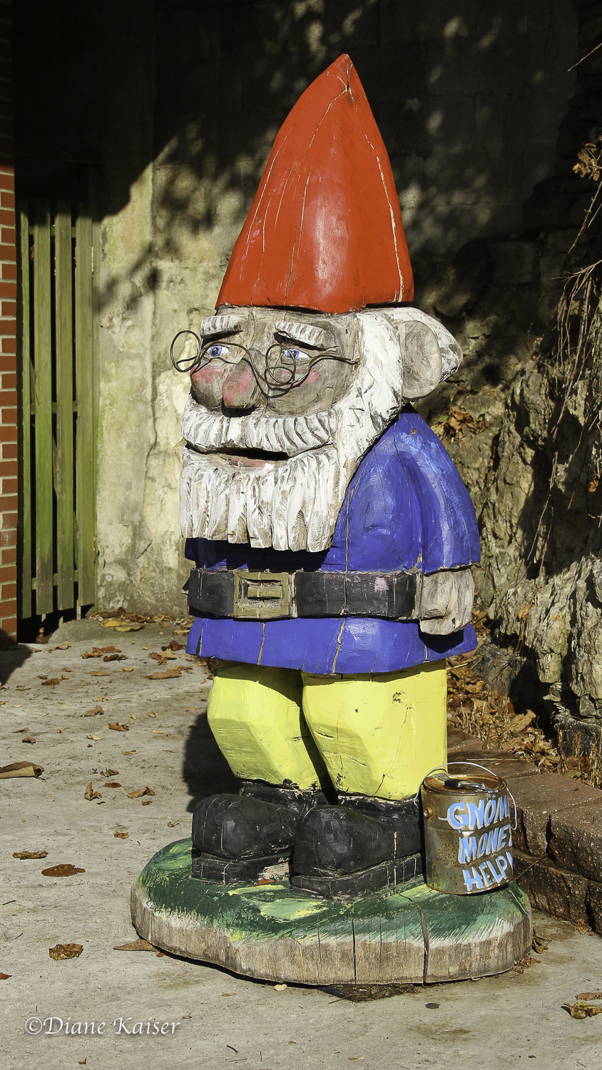 There were several of these gnomes around town. Some had money in their can!