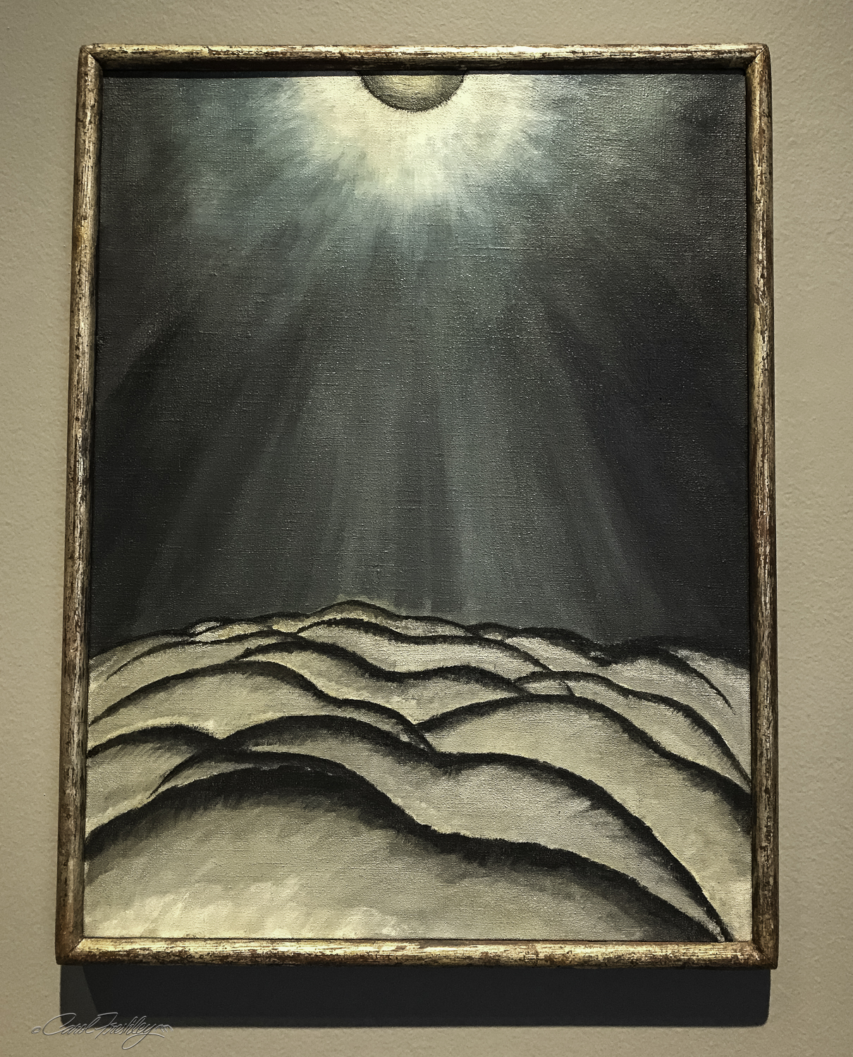 "I loved this painting!  It was done by Arthur Dove (1880-1946) and is titled, Moon and Sea No. II.  Dove describes the storm he was hoping to express, ""It is now 3:45 a.m. in the midst of a terrific gale and we are anchored in the middle of Manhasset Bay, held by a 3/4 inch line run through a shackle to a mooring.  Have been trying to memorize this storm all day so I can paint it.  Storm green and storm gray.""  Dove is considered America's first abstract painter, striving to make the basic processes of nature visible in his work."