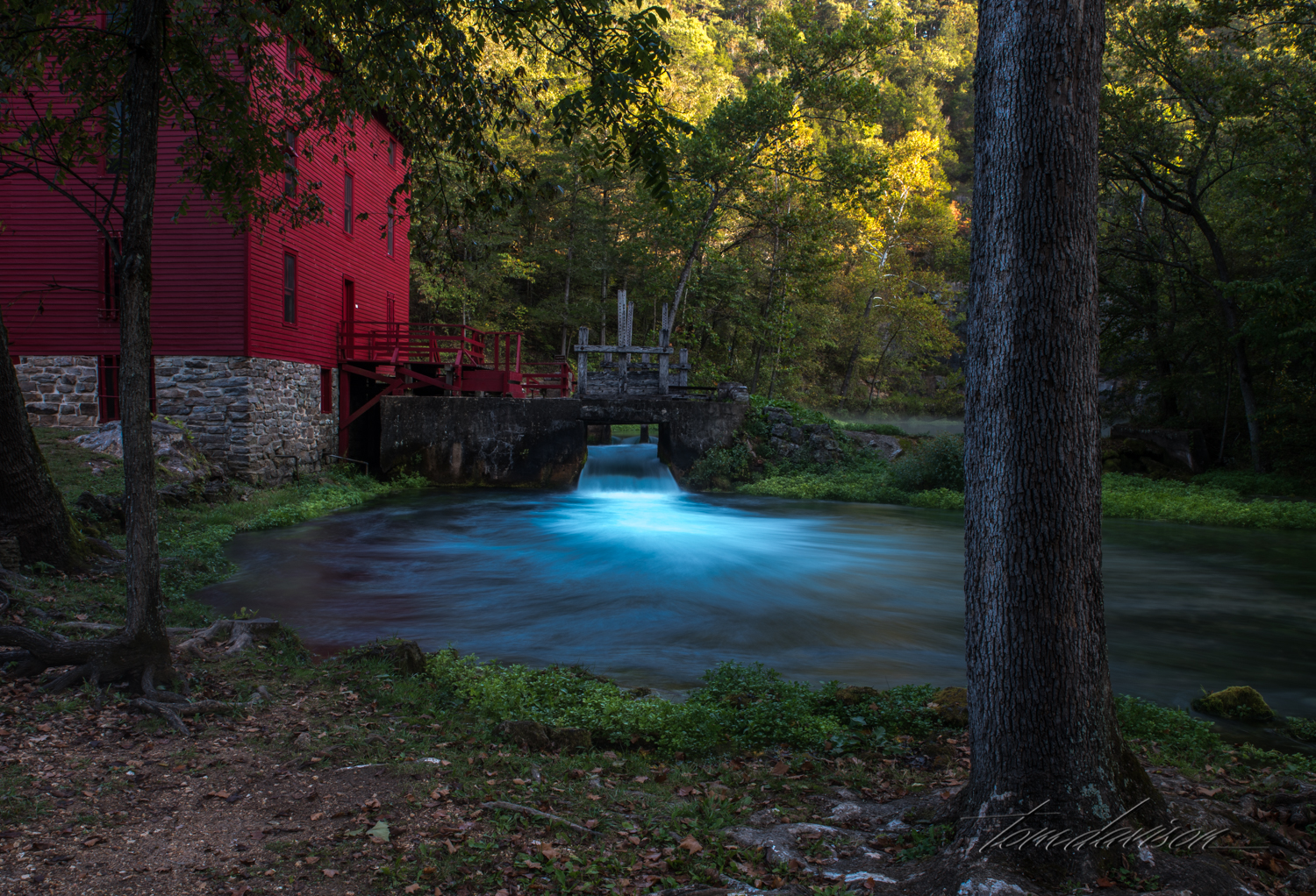 """As the sun rose, it was easier to appreciate the richness of the scene. Are you thinking, """"Where is the waterwheel?"""" This mill did not have one! Instead, it was built in 1894 with what was considered modern machinery at the time. Steel rollers were used for grinding and the exterior water wheel was replaced by a submerged turbine. The speed of the turbine was controlled by managing the amount of water that went through the 'gate'."""