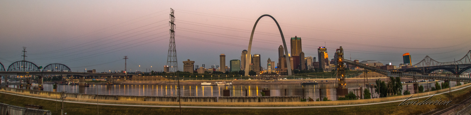 A fish-eye photograph showing the two bridges on each side. Bridges crossing the river are the transportation lifelines of St. Louis and were a major consideration in the design and placement of the arch.