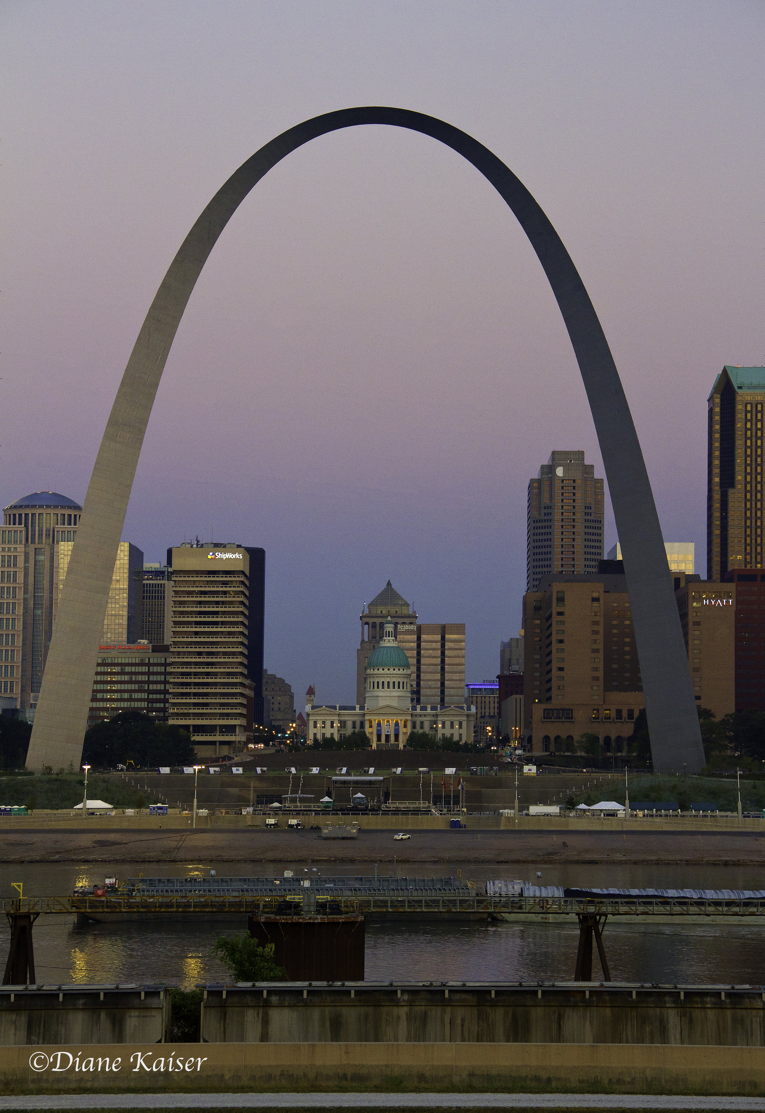 This is an important image to have in your 'bucket list' file. There is a lot of information about how the Old Courthouse would be used as the centerpiece in the arch's orientation. The arch frames that important city icon. You can also notice that barges are already moving down the river in the early morning hours.