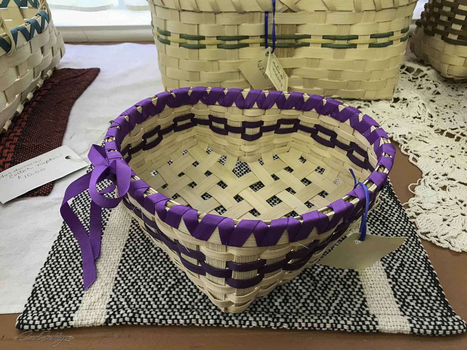 Basket weaving was probably not done this way a hundred years ago. But, the craftswoman noted that crafts have always evolved to meet current need and 'market demand'. So true.
