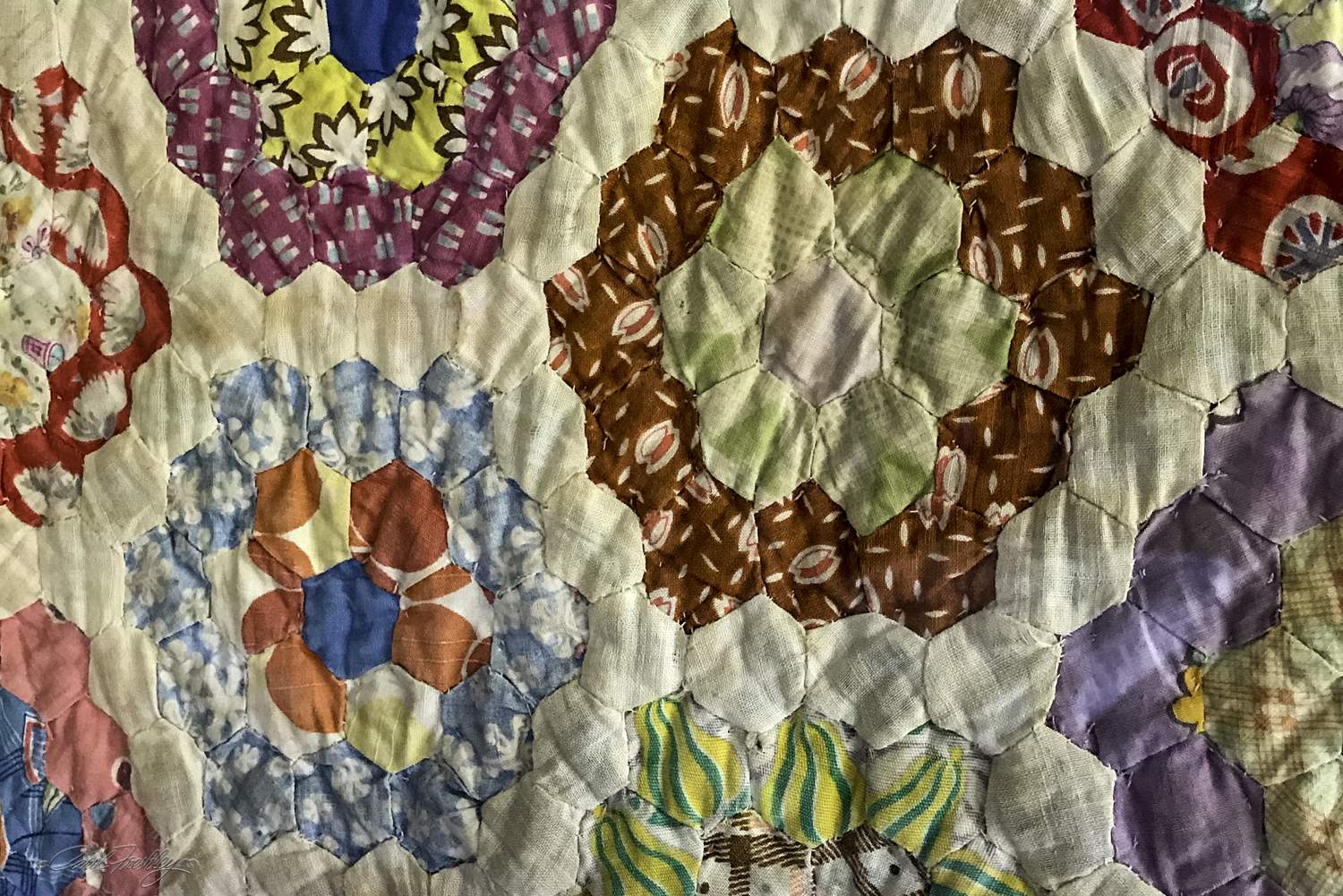 The woman at the quilt shop was very excited about a gift she had received earlier in the day of a grocery bag full of old flour bags. She explained that early flour mills found marketing advantage in putting their flour in fabric bags that could be used for making clothing item, and more importantly, quilts. The photo above shows a small portion of such a quilt.