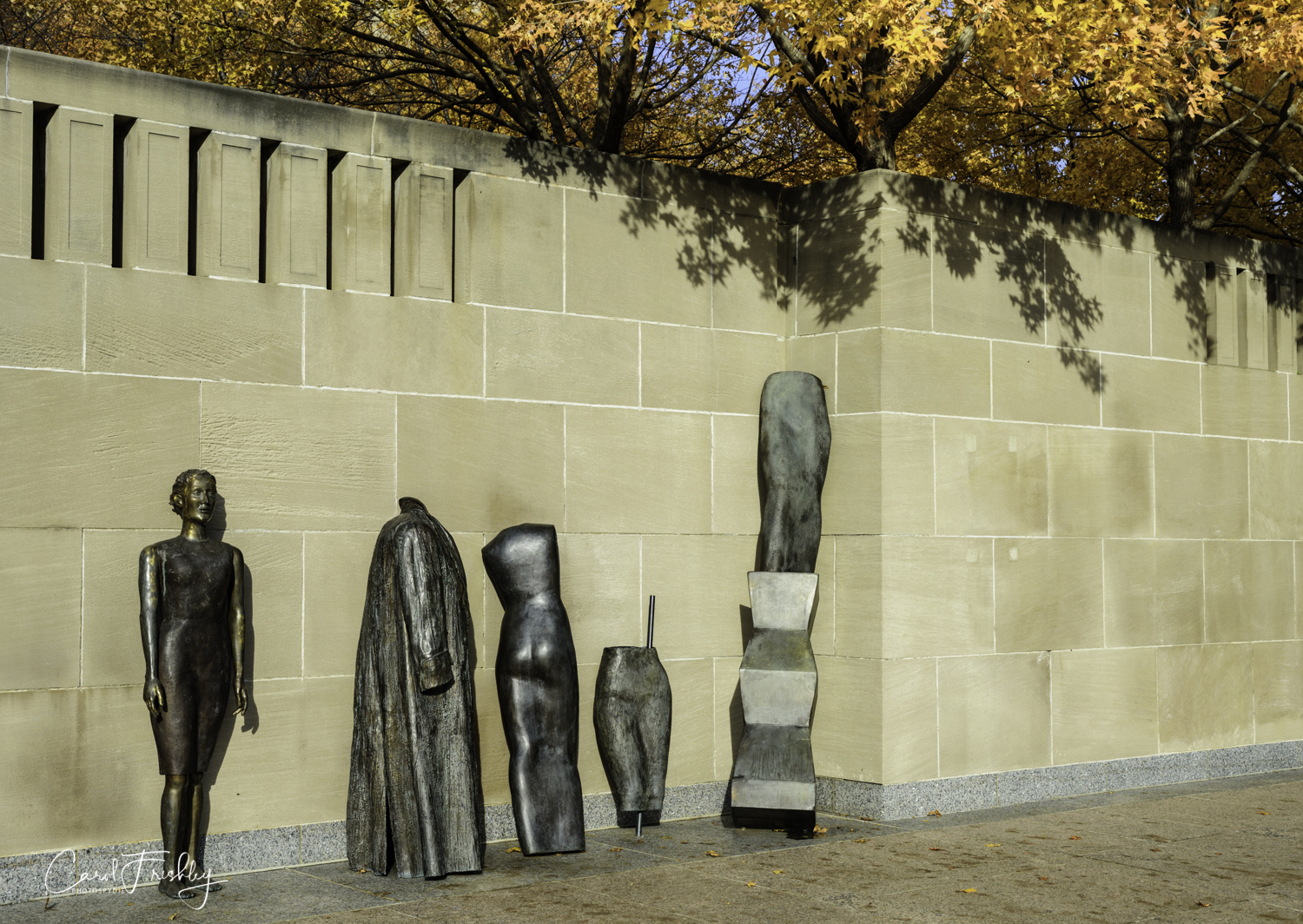 "This is  Storage  by Judith Shea, an American artist born in 1948.  She ""initially worked as a fashion designer.  Later, she began making figurative sculptures, a radical idea in the avant-garde world of abstract art.   Storage  includes a hollow coat and dress, motifs that Shea uses frequently in her work.  Shea stated, ""They lean propped up against the wall essentially as if forgotten or stored.  The truncated clothing forms provided an essence - no extremities, no movement; it was a way to express the essence of human presence.""  Cast in 1999 of bronze."