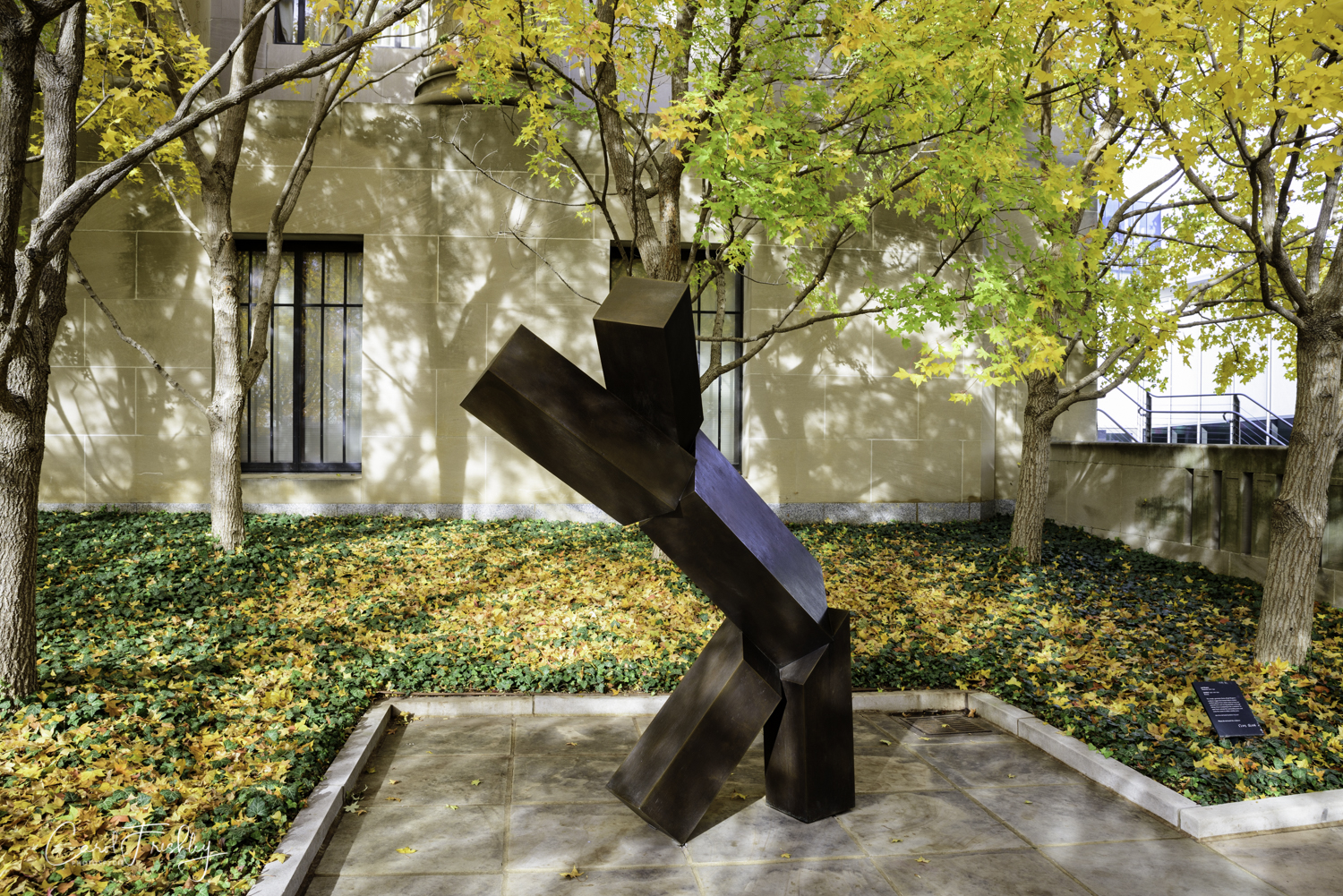"""This simple, geometric forms of Joel Shapiro's sculpture suggest the human body in motion.   Untitled  appears from certain views to have two upraised arms and one leg extended, as though taking a bow or preparing to do a cartwheel.  Its open form activates the surrounding space and invite the viewer to strike a similar pose.  Joel Shapiro, Amerian born 1941, cast in 1992 of bronze."
