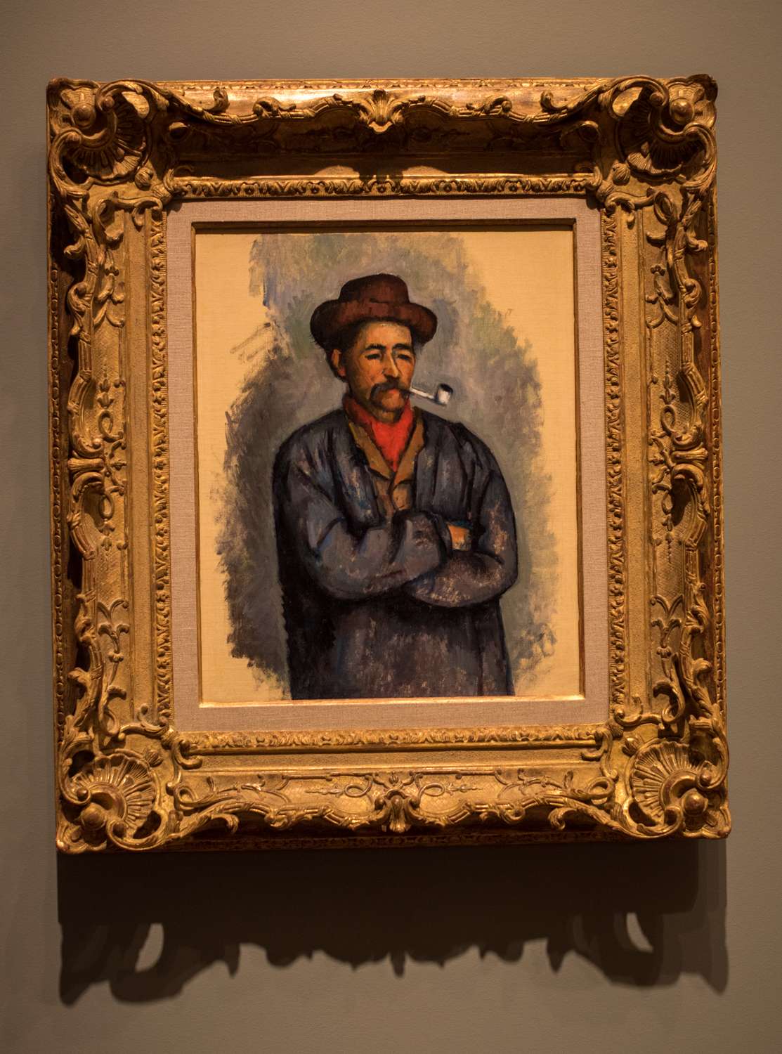 """Man with a Pipe, 1890-1892 by Paul Cézanne (1839-1906), oil on canvas. The artist wrote' """"I love above all else the appearance of people who have grown old without breaking with old customs."""" This painting is one of a group of studies related to  The Card Players, one of Cézanne's most important pictorial projects. The local workers reminded him of qualities he admired - steadfast, unchanging, and monumental."""
