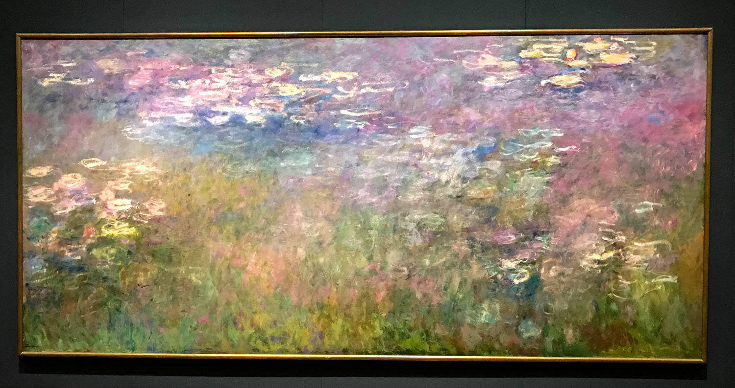 """Water Lilies , 1915-1926 by Claude Monet (1840-1926) oil on canvas. From the informational tag: """"In 1893, Claude Monet bought land adjacent to his property in Giverny, dug a pond and turned it into a Japanese-inspired water garden. This contemplative environment served as inspiration for a series of paintings that occupied Monet's artistic productions from 1901 until his death in 1926. Typical of his other paintings dedicated to the water lily pond, the subject here is not so much tho flowers but the dream-like effects produced by light reflecting off this liquid world."""""""