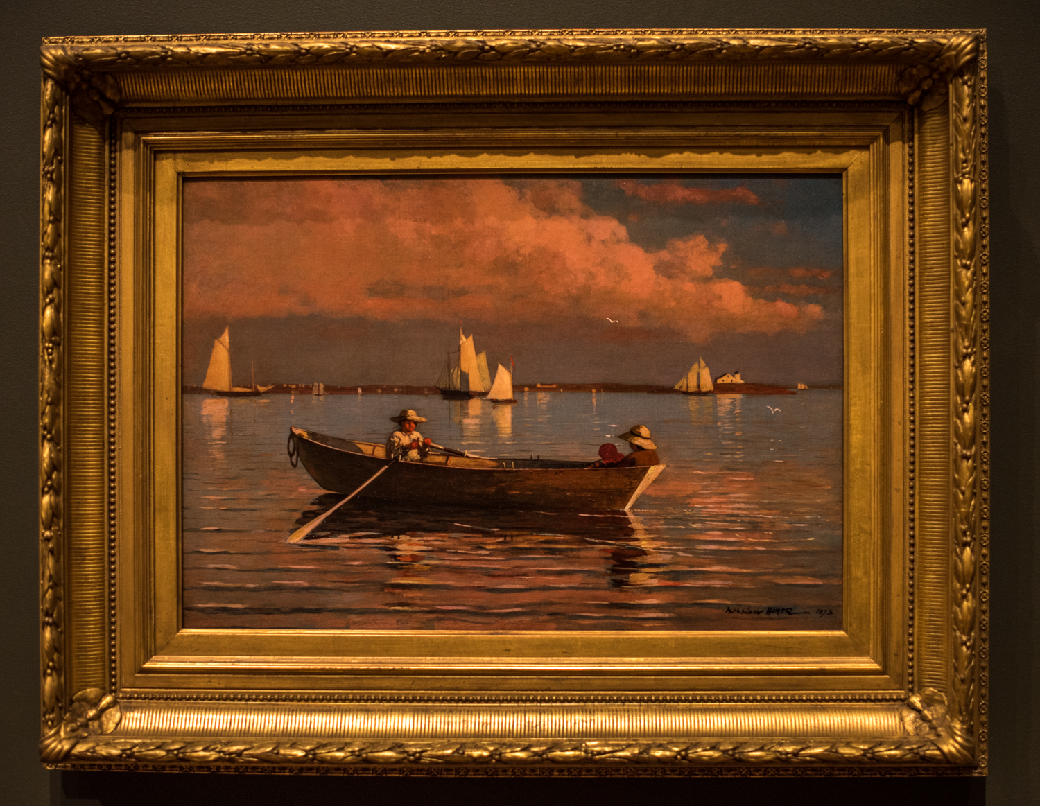 """Gloucester Harbor, 1873,by Winslow Homer (1836-1910), oil on canvas. """"Winslow Homer is best known for his dark, brooding seascapes of the 1890s. In the 1870s, however, he was distinguished for scenes of children at play that were considered decidedly lacking in sentimentality. This view of three children in a dory in Gloucester Harbor, Massachusetts, not only depicts a delightful summer outing, but also suggests, by the presence of the huge schooners in the background, the boys' possible future livelihood."""""""