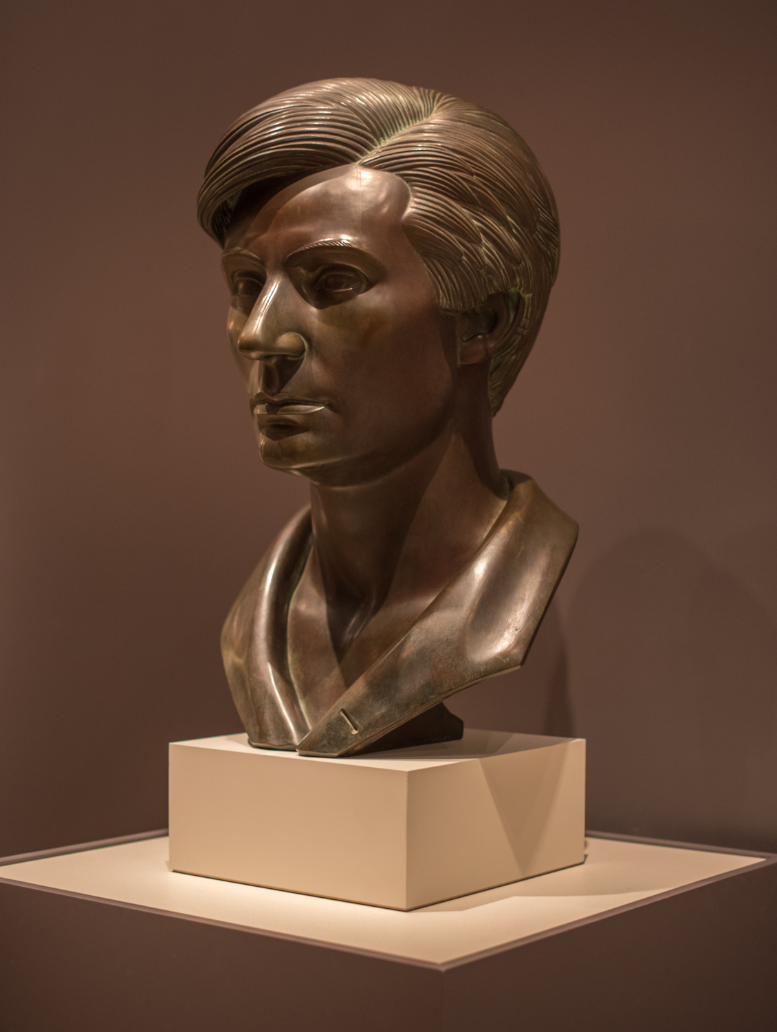 """Head of Abe Lincoln, the Hoosier Youth, about 1932, Paul Manship (1885-1966), Bronze. """"Representations of Abraham Lincoln abounded throughout the Great Depression, elevating the former president as a champion of the common man. The image of him as a hearty youth full of promise was the most popular. This large sculpted portrait by Paul Manship was commissioned for the Lincoln Life Insurance Company in Fort Wayne, Indiana. Responding to the wishes of his clients, Manship portrayed a young Lincoln. The artist imagined his subject at age 21, creating this image using the smooth modeling and simplified forms of Art Deco."""""""