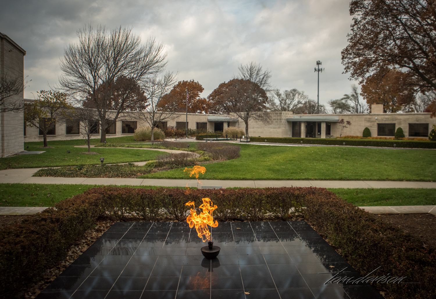 Harry Truman is buried in the courtyard of his Presidential Library.