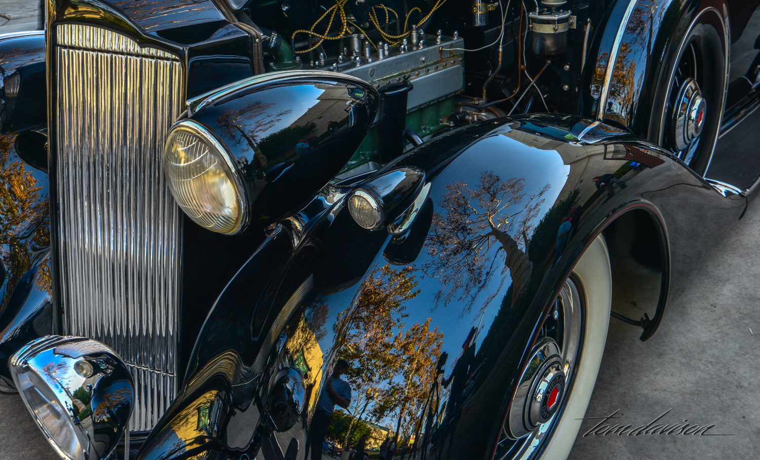 Reflections on 1937 Packard fender.