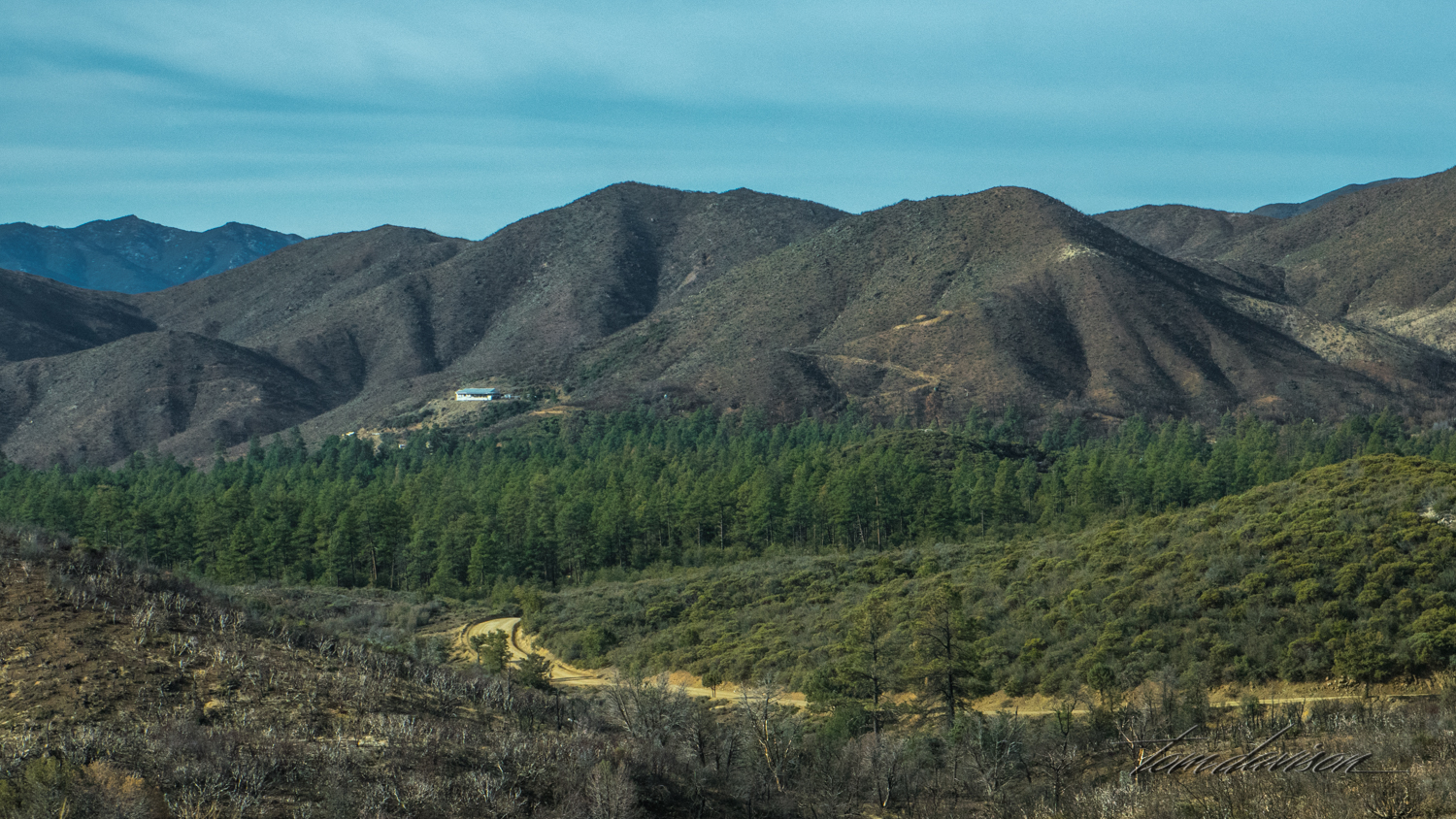 This one valley seemed to be spared from the burn. It is a small community and probably got some very important fire fighting protection. It does show the vegetation that probably covered a much larger area before the fire.