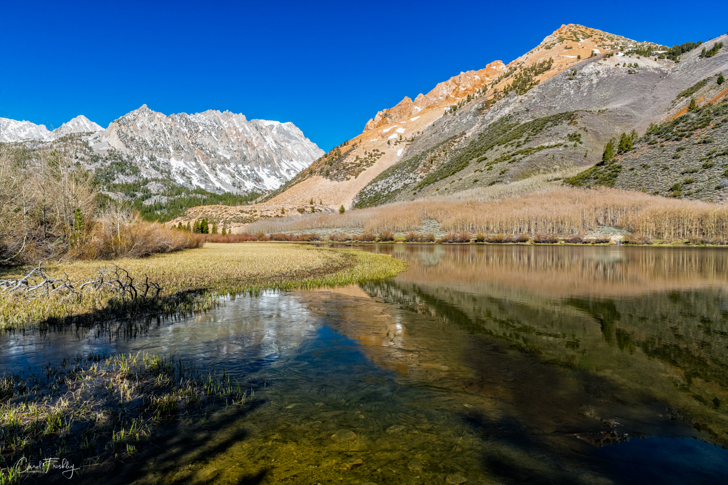 All three lakes are accessed from Bishop on Highway 168.  The road into North Lake was just opened and we were anxious to check it out.  If this scene looks familiar and you are a 'Mac' person you may recognize it as the opening screen on new Apple computers.  But the vivid color of fall that you see in that photo looks much more toned down in the spring before the aspen across the lake have even started leafing out.  You may notice the very thin layer of ice along the water's edge in this photograph.